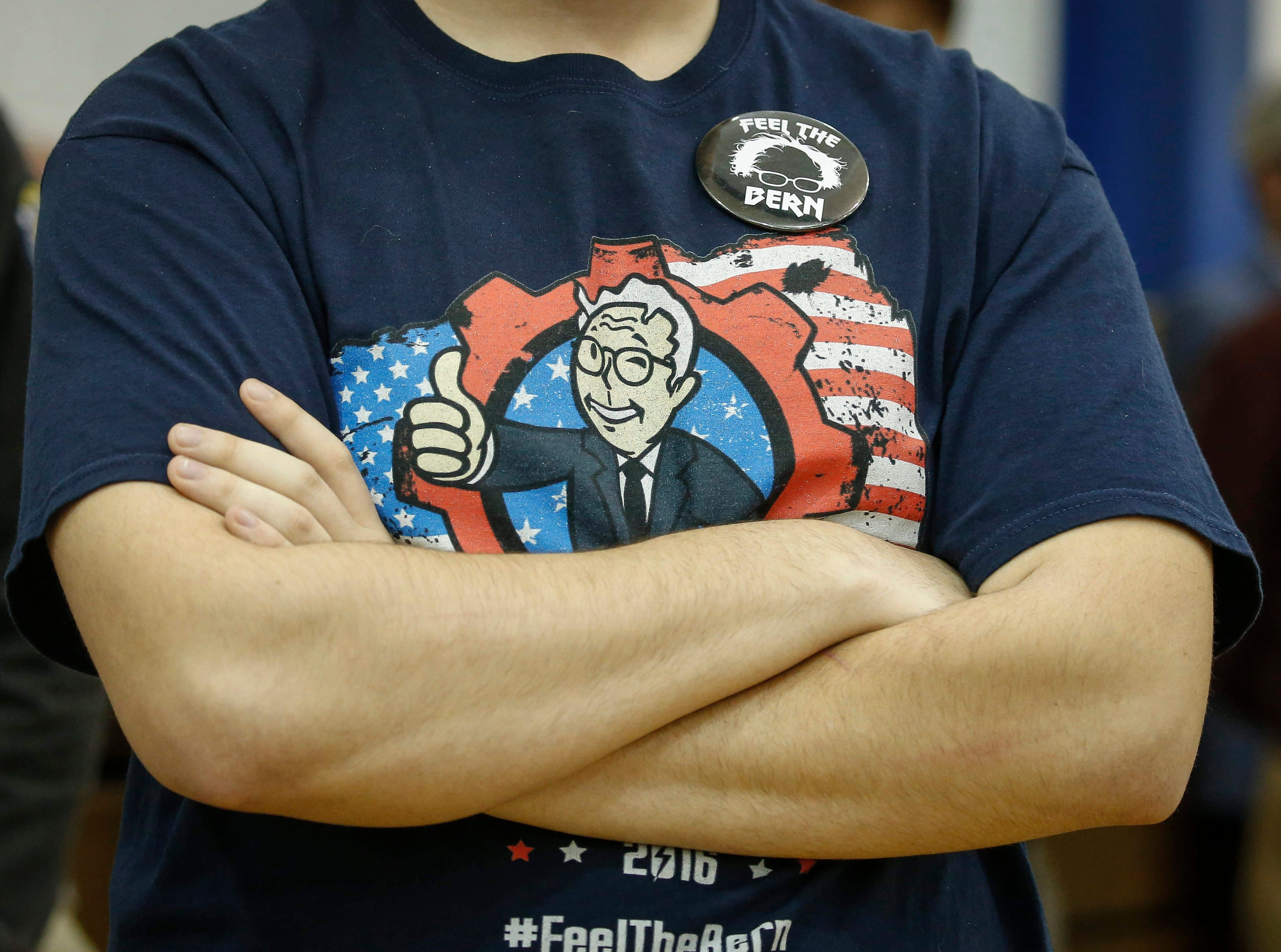 A fan of Democratic presidential candidate hopeful Bernie Sanders dons a Feel the Bern t-shirt as Sen. Sanders speaks to eastern Iowans during a town hall style meeting at West Middle School in Muscatine on Saturday, April 6, 2019.
