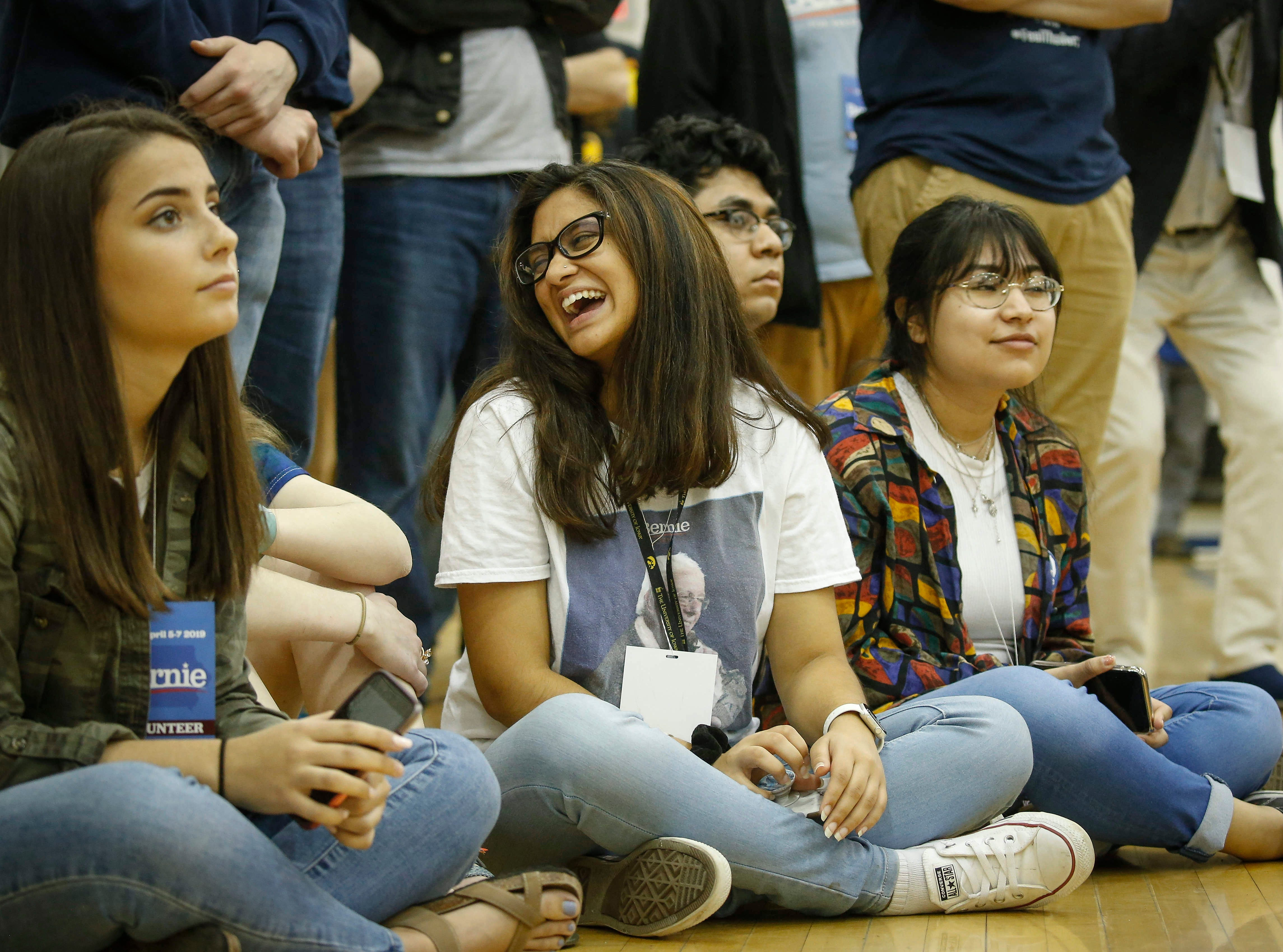 Young supporters of U.S. Sen. Bernie Sanders take a seat on the floor as the Democratic presidential candidate hopeful speaks during a town hall meeting at West Middle School in Muscatine on Saturday, April 6, 2019.