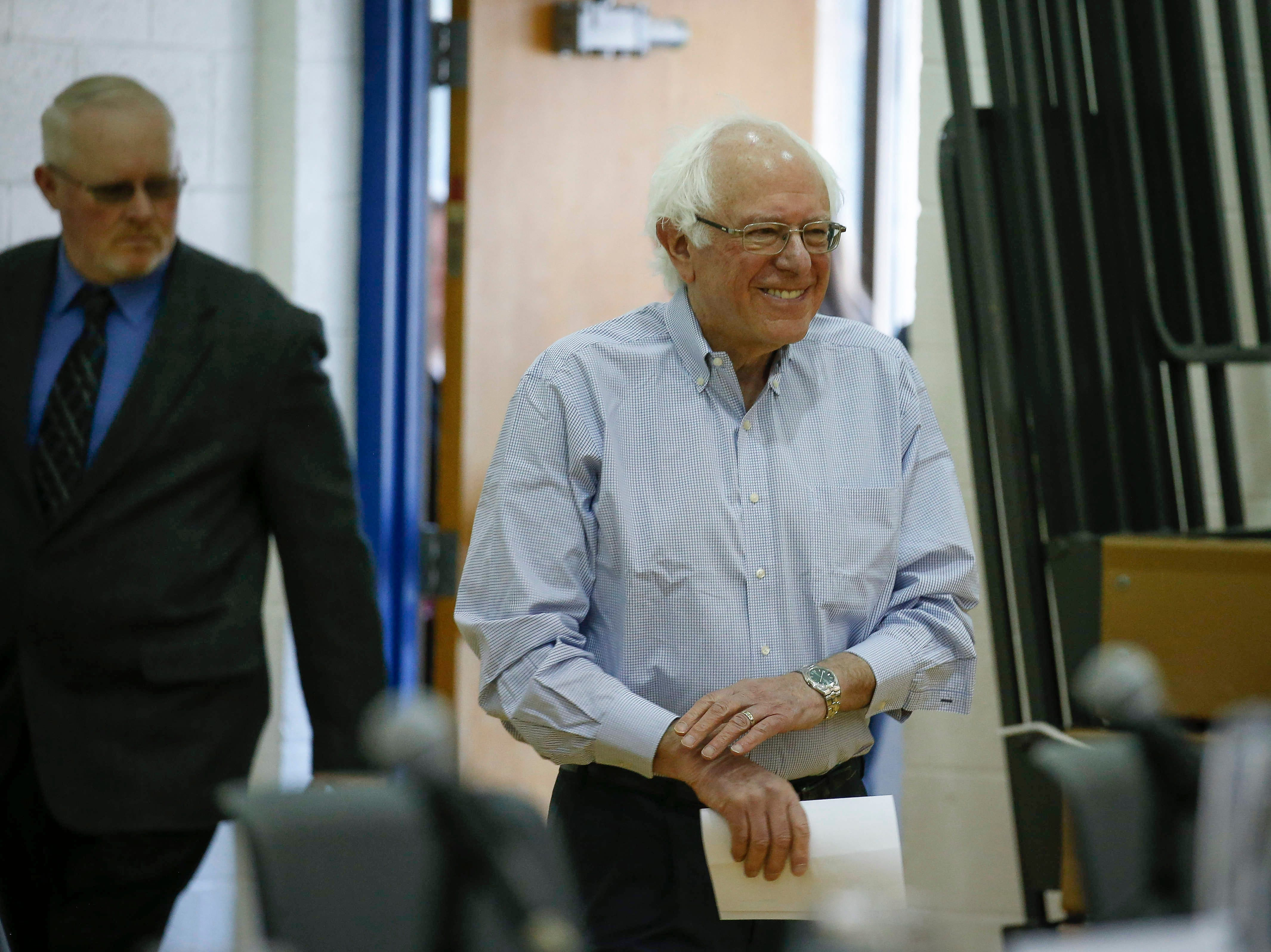 U.S. Senator and Democratic presidential candidate hopeful Bernie Sanders enters the room for a town hall style meeting at West Middle School in Muscatine on Saturday, April 6, 2019.