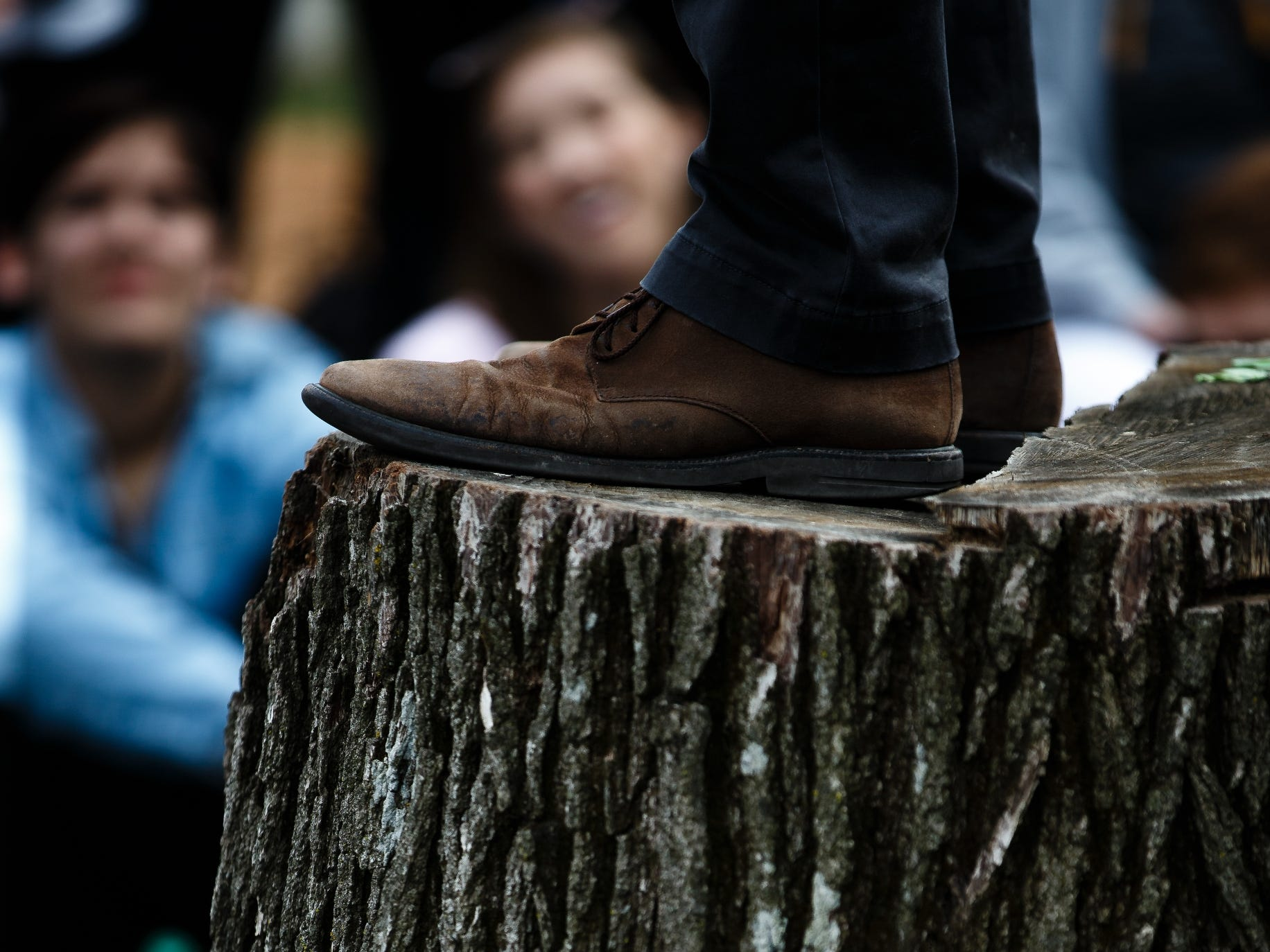 2020 Democratic presidential candidate and former Texas Representative Beto O'Rourke stands on a tree stump to give his speech in Marshalltown during a swing though Iowa on Friday, April 5, 2019, in Marshalltown.