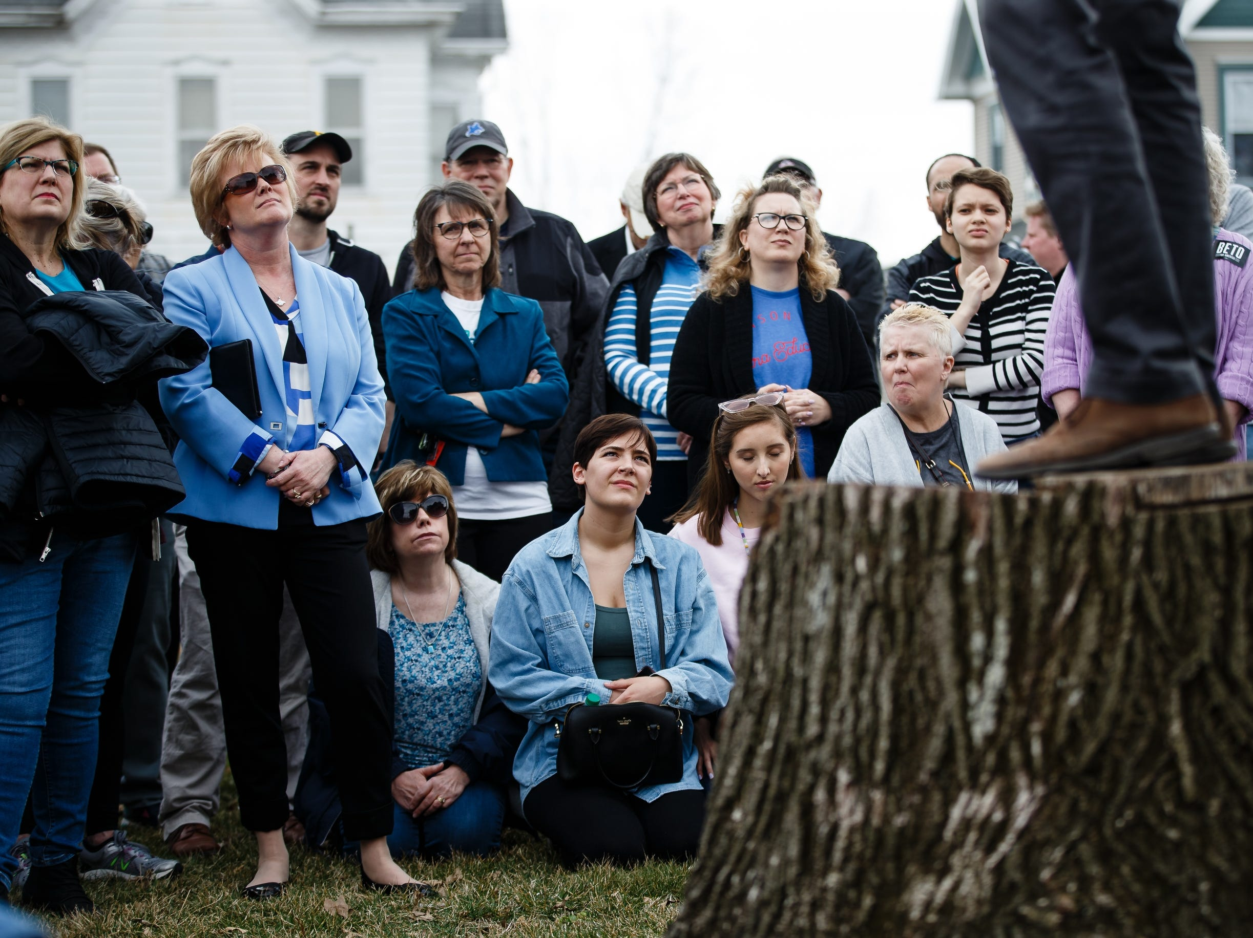 People listen as 2020 Democratic presidential candidate and former Texas Representative Beto O'Rourke stands onto a stump to give his speech in Marshalltown at the Mowry Irvine Mansion during a swing though Iowa on Friday, April 5, 2019, in Marshalltown.
