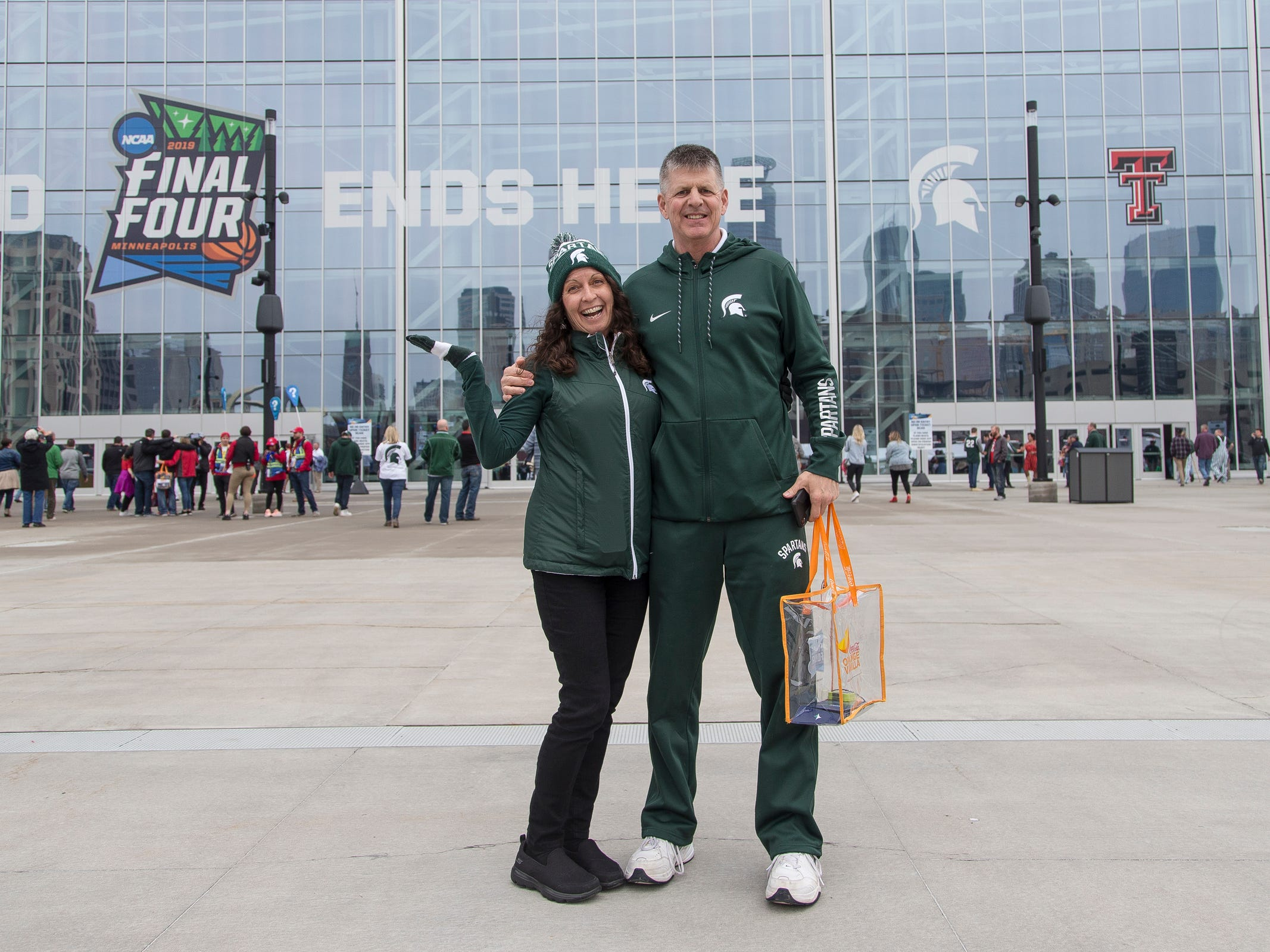 Marie Vernon and her husband Rick, both of Lansing, pose for a photo before the Final Four against Texas Tech at U.S. Bank Stadium in Minneapolis, Saturday, April 6, 2019.