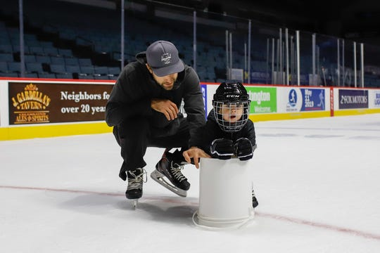 Matt Ford, who plays for the Grand Rapids Griffins of the AHL, skates with his 2-year-old son, Bennett.