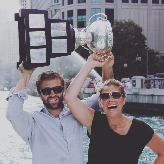 Matt Ford, who plays for the Grand Rapids Griffins of the AHL, holds up the Calder Cup with his wife, Cassie.