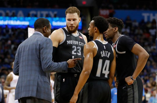 Detroit Pistons head coach Dwane Casey coaches his team against the Oklahoma City Thunder during the first half at Chesapeake Energy Arena.