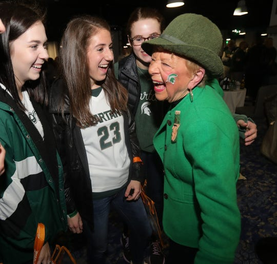 Super Spartans fan Jan Alleman Trumbull talks with her fans after a rally before the MSU NCAA Semifinal game against Texas Tech Friday, April 5, 2019 at US Bank Stadium in Minneapolis , MN.