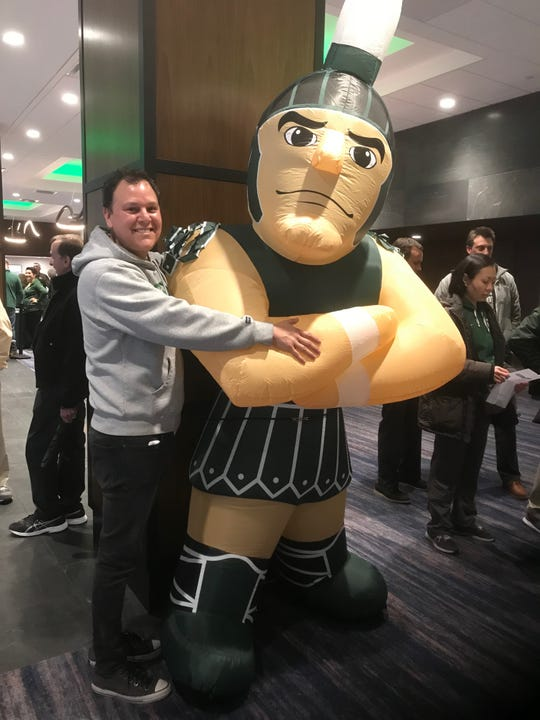 Eloy Trevino, 43, a Michigan State alumnus, poses with Sparty in Minneapolis. She flew from Lima, Peru to attend the Final Four.