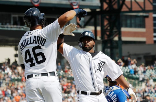 Tigers left fielder Christin Stewart is congratulated by Jeimer Candelario after hitting a grand slam during the seventh inning on Saturday, April 6, 2019, at Comerica Park.