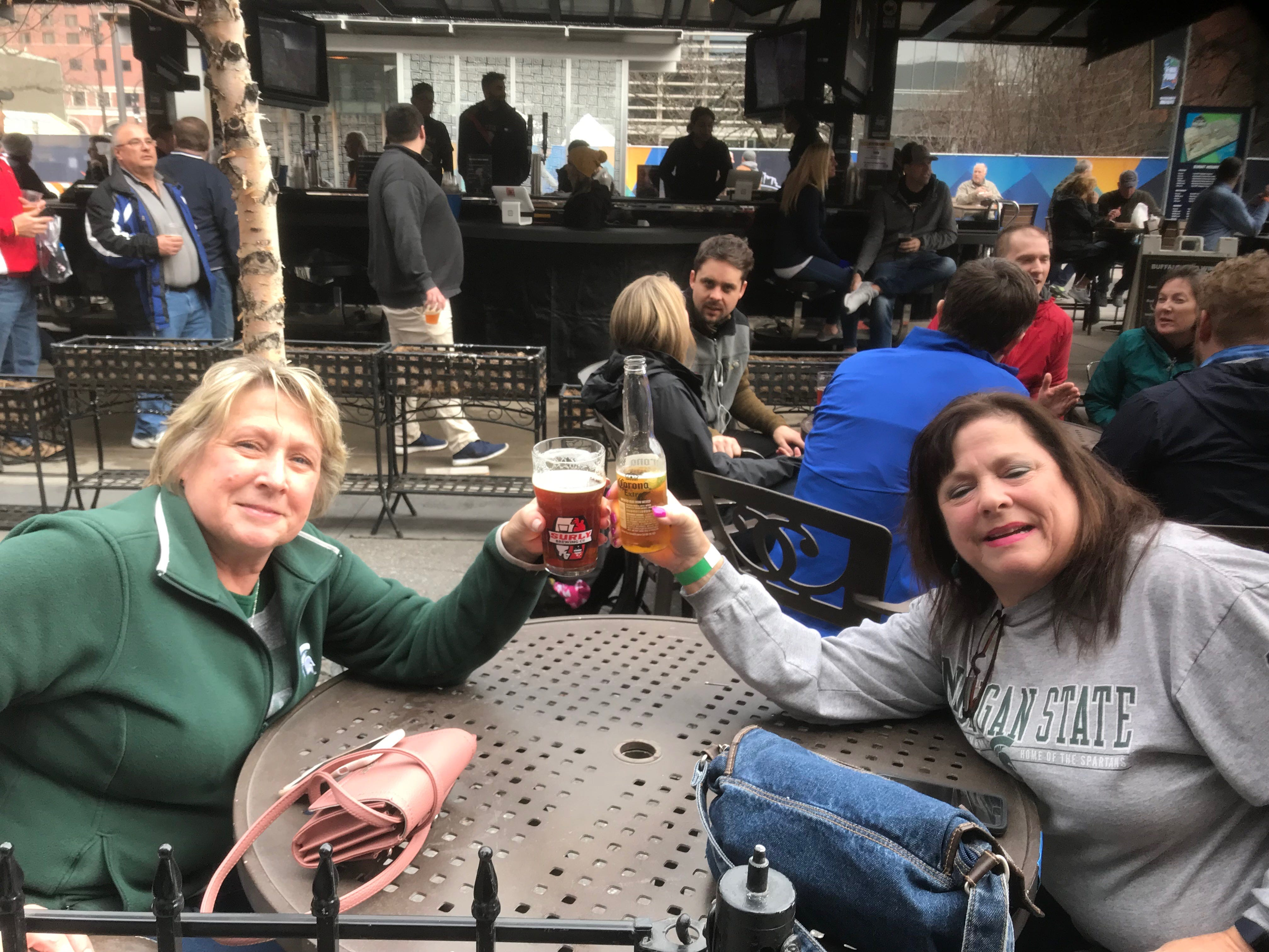 Michigan State University alums and former college roommates Kerry Quast, left, 59, a Birmingham native who now lives in Ohio, and Patty Walters, 59, of New Mexico met up in Minneapolis for the Final Four after years of watching Spartan basketball games together over text.