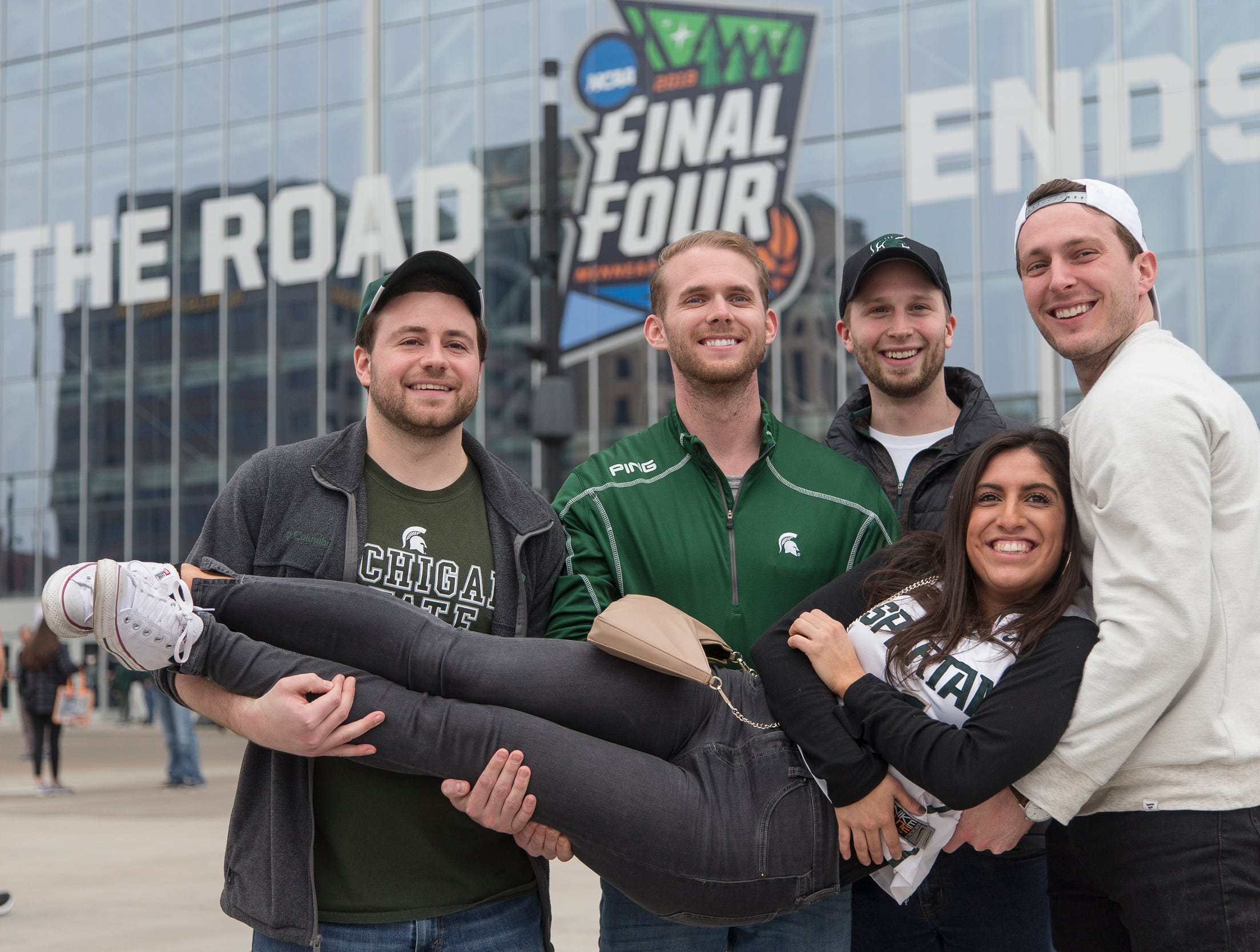 From left, Michigan State alumni Nick Gonyea of Detroit, Nick Druzinski of Detroit, Daniel Doroh of Chicago, Ill., John Venn and Kate Lieberman, both of Milwaukee, Wis., pose for a photo before the Final Four against Texas Tech at the U.S. Bank Stadium in Minneapolis, Saturday, April 6, 2019.