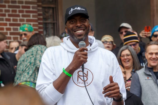 Former Detroit Pistons basketball player, John Salley, speaks to attendees during the 48th annual Hash Bash on Saturday, April 6, 2019 at U-M's Diag in Ann Arbor.