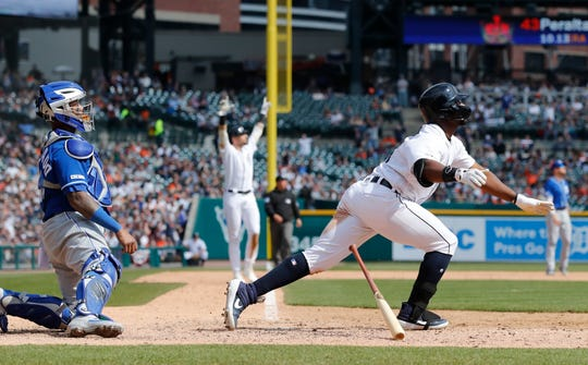 Tigers left fielder Christin Stewart watches his grand slam clear the outfield wall during the seventh inning on Saturday, April 6, 2019, at Comerica Park. In the background is Nicholas Castellanos raising his arms in celebration.