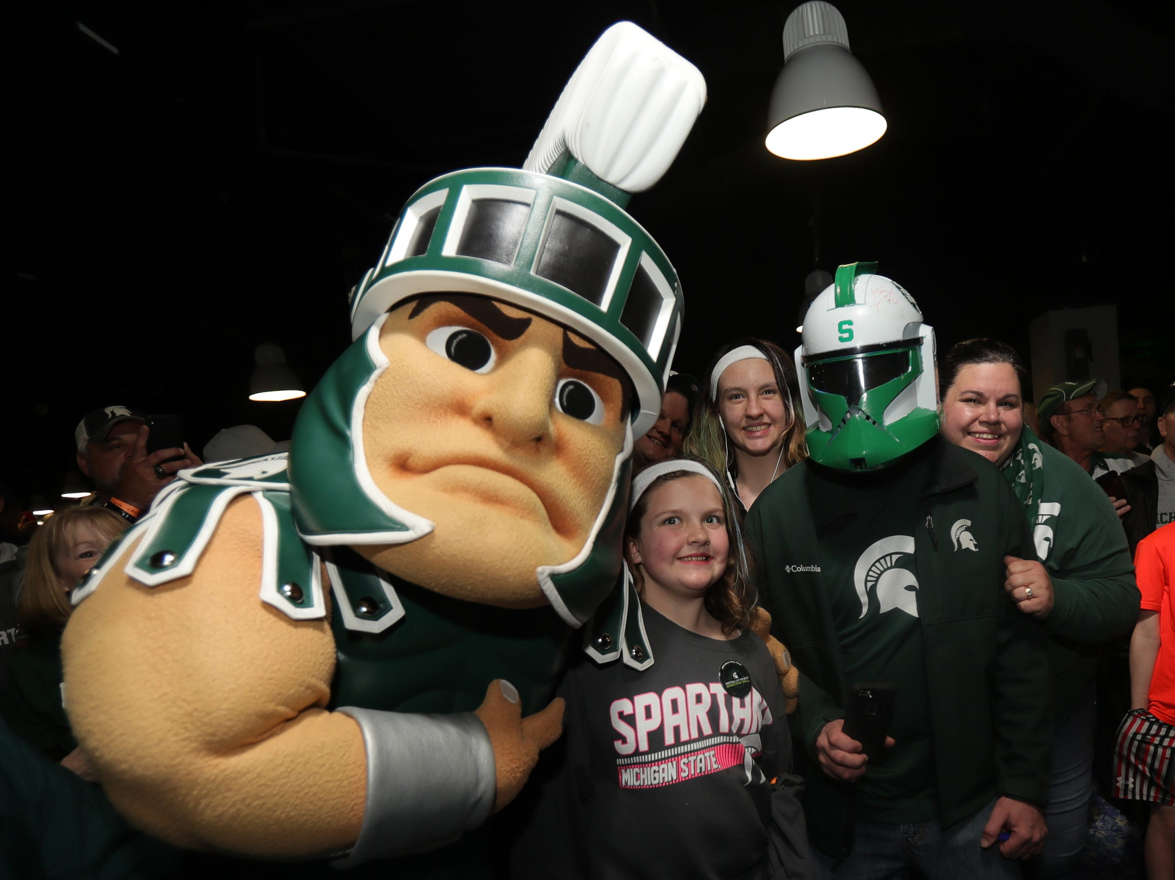 Sparty poses with Michigan State fans Ashley Geib, Madison Geib, Jim Geib and Kristin Geib cheer during a rally before the MSU NCAA semifinal game against Texas Tech, Friday, April 5, 2019 at US Bank Stadium in Minneapolis.