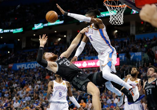 Detroit Pistons forward Blake Griffin (23) collides with Oklahoma City Thunder forward Nerlens Noel (3) on the way to the basket during the first half at Chesapeake Energy Arena.