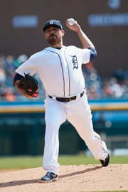Tigers starting pitcher Matt Moore pitches in the first inning against the Kansas City Royals at Comerica Park.