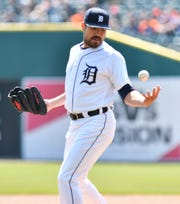 Tigers pitcher Matt Moore snags a come-backer in the first inning and then gets the out at first. He left the game after straining his knee in the third inning.