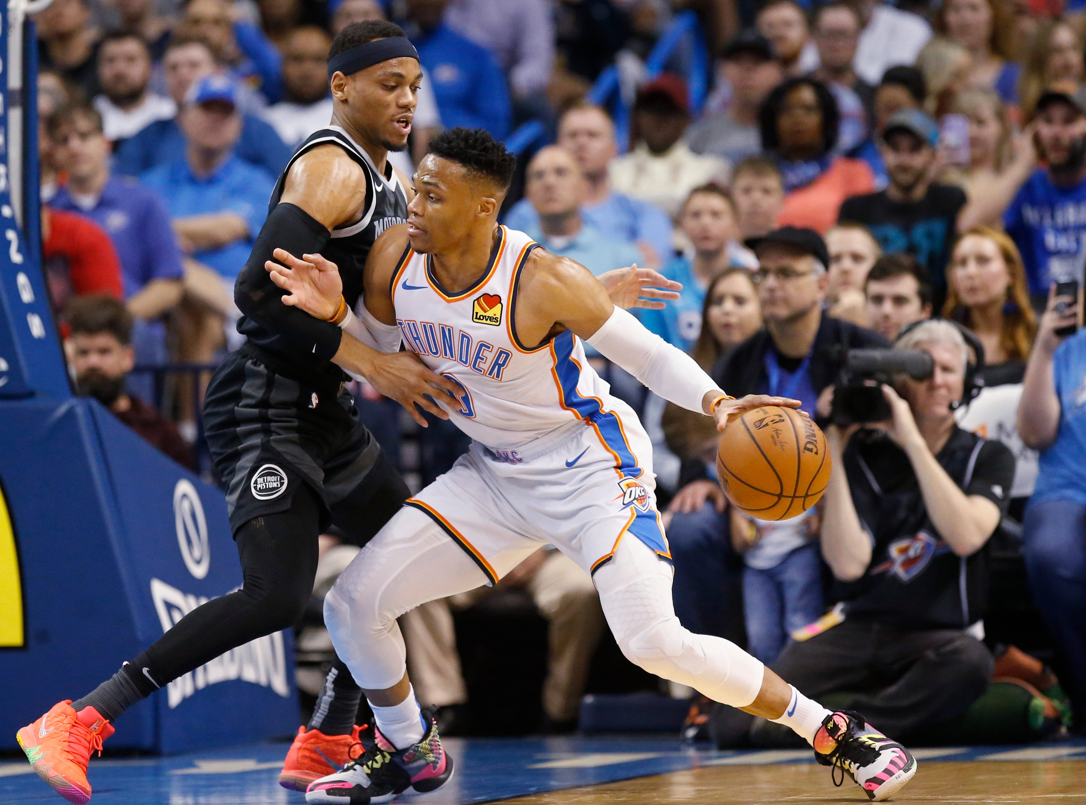 Oklahoma City Thunder guard Russell Westbrook, right, drives against Detroit Pistons guard Bruce Brown during the first half.