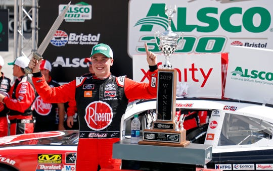 Driver Christopher Bell celebrates in Victory Lane after winning the NASCAR Xfinity Series auto race on Saturday in Bristol, Tenn.