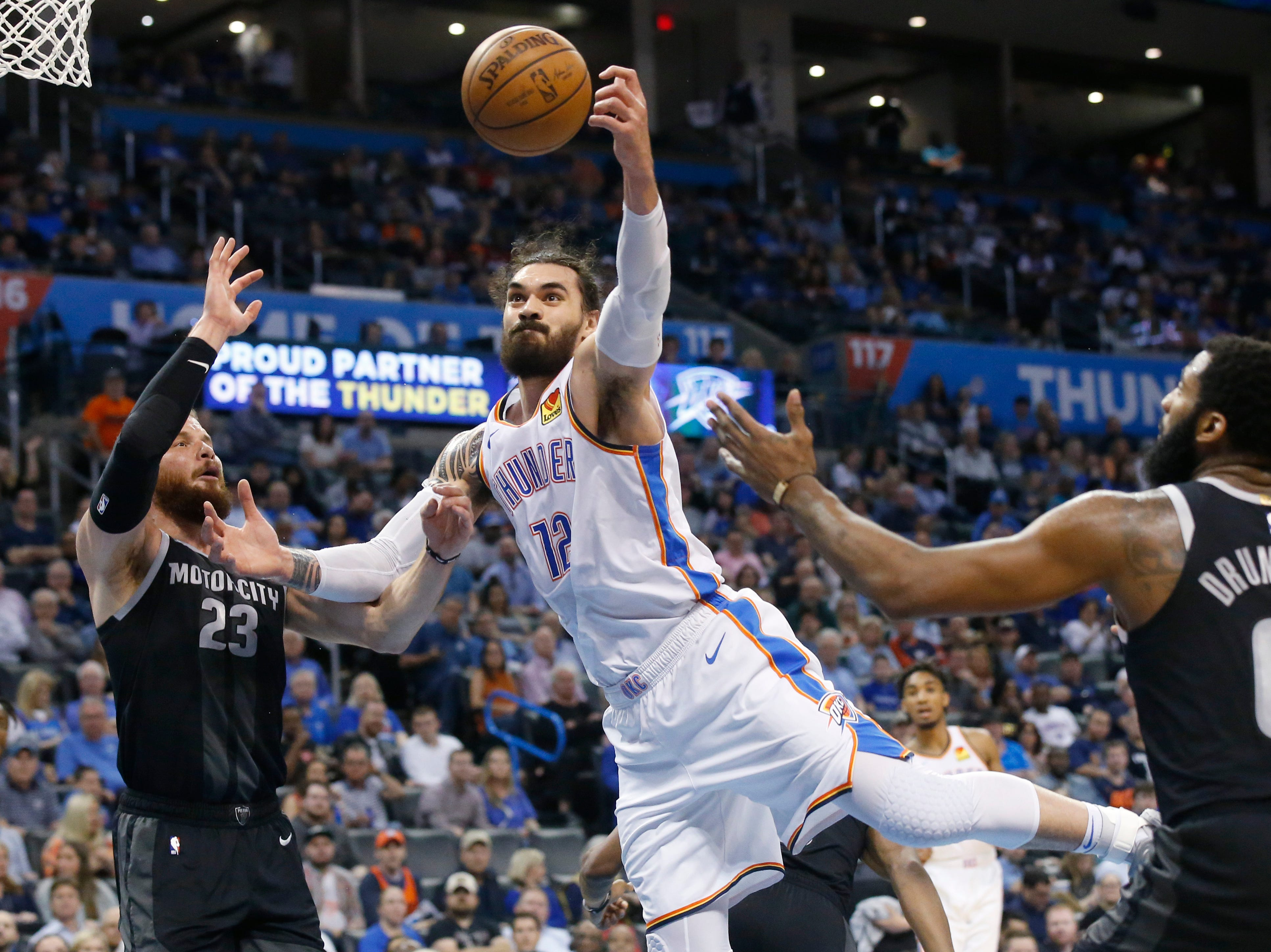 Oklahoma City Thunder center Steven Adams (12) reaches for a rebound between Detroit Pistons forward Blake Griffin (23) and center Andre Drummond (0) during the second half.