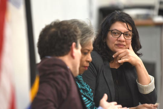 U.S. Representatives Andy Levin, left, Brenda Lawrence and Rashida Tlaib listen during a meeting concerning the Iraqi deportations at the Chaldean Community Center on Saturday.