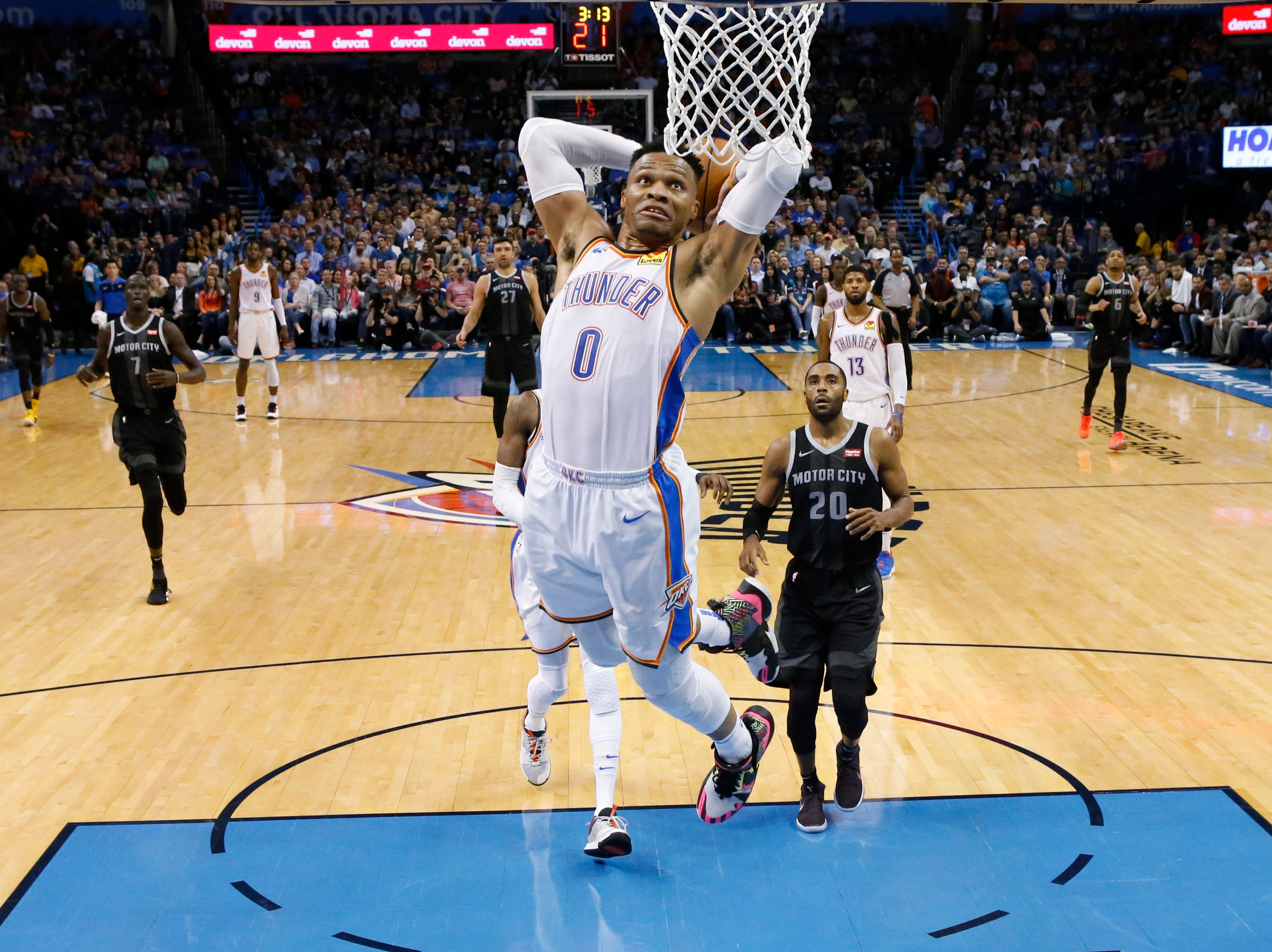 Oklahoma City Thunder guard Russell Westbrook (0) goes up for a dunk in front of Detroit Pistons guard Wayne Ellington (20) during the first half.