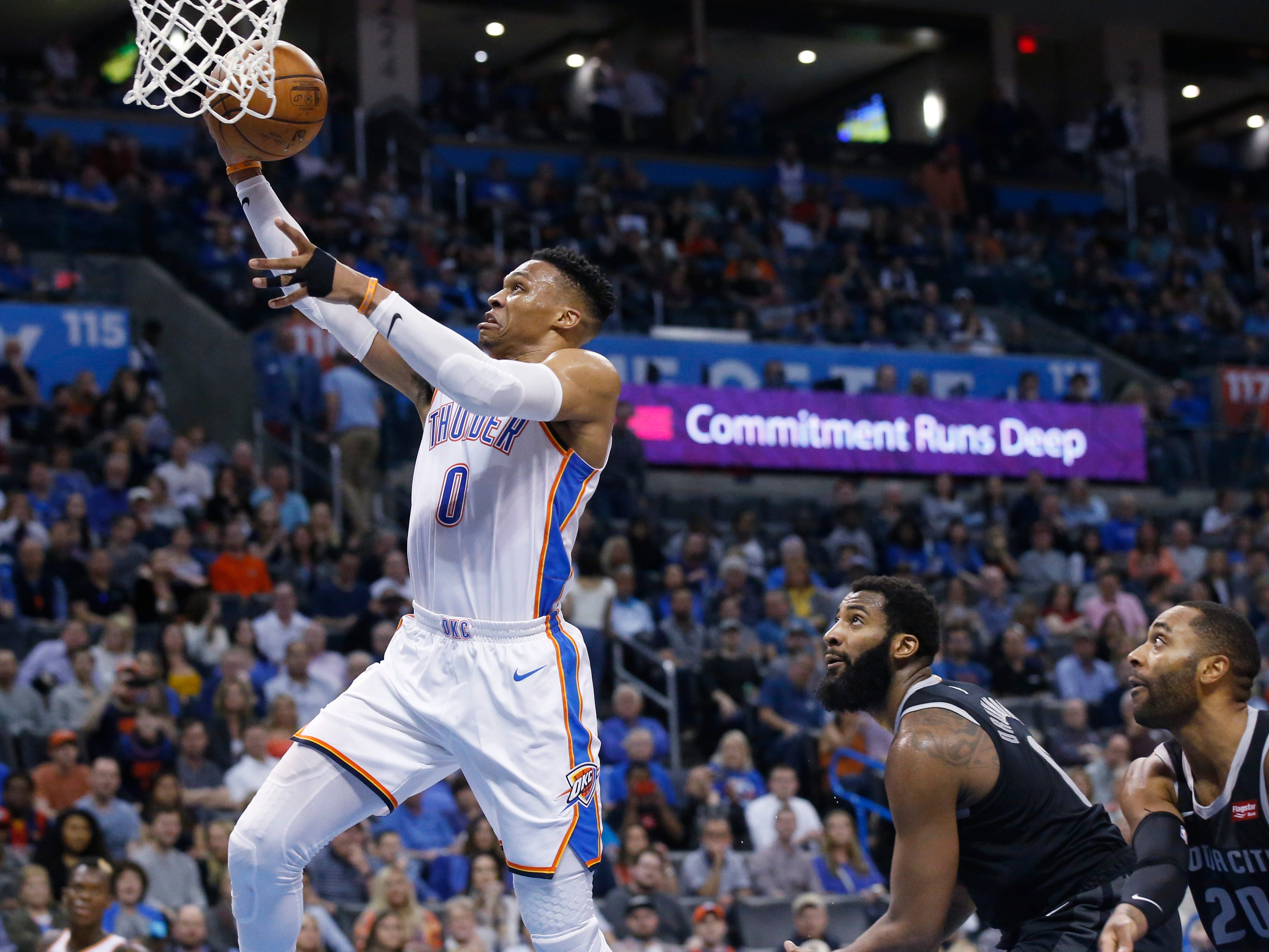 Oklahoma City Thunder guard Russell Westbrook (0) goes to the basket in front of Detroit Pistons center Andre Drummond, center, and guard Wayne Ellington (20) during the second half.