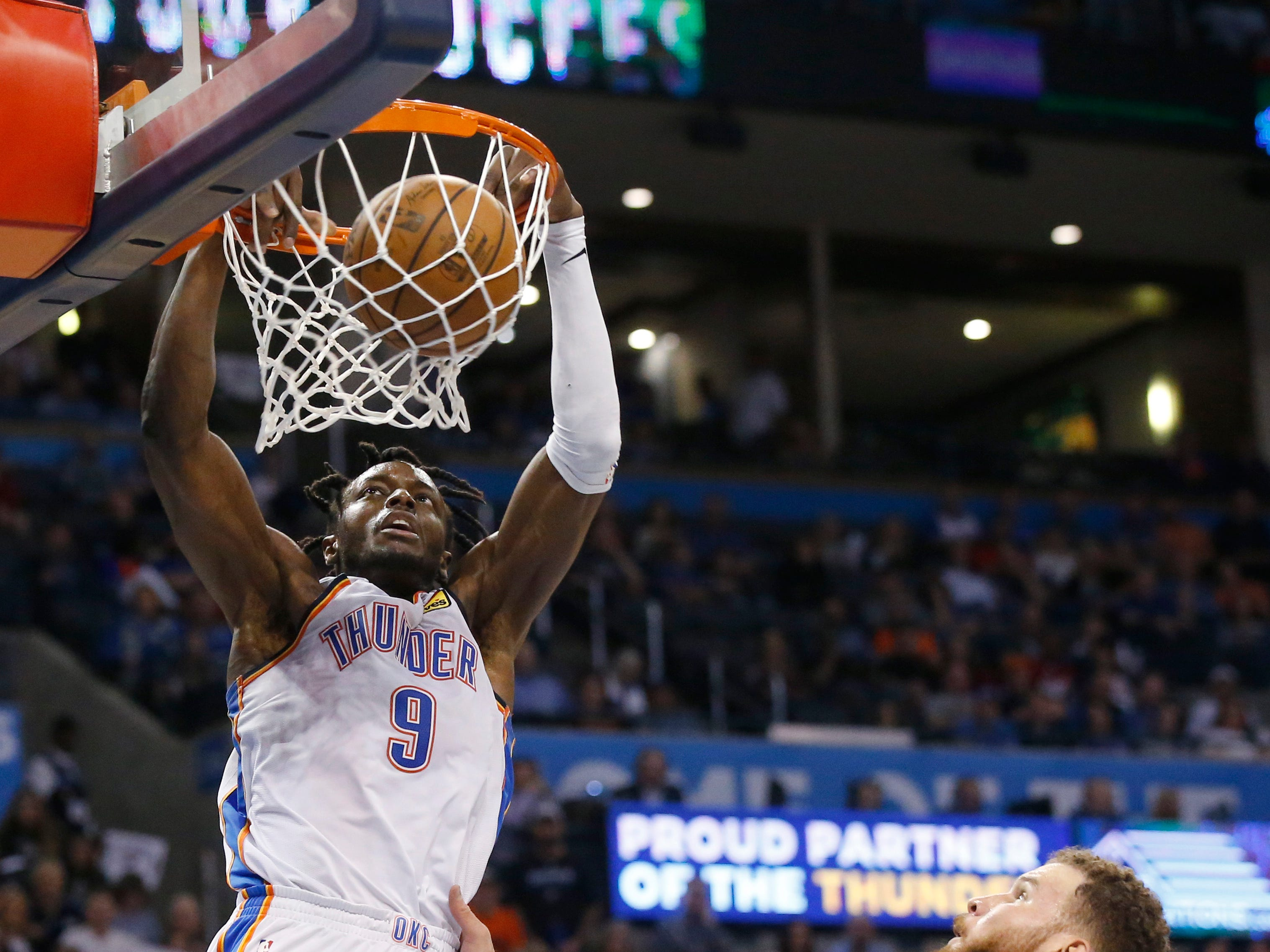 Oklahoma City Thunder forward Jerami Grant (9) dunks in front of Detroit Pistons forward Blake Griffin (23) during the second half of an NBA basketball game Friday, April 5, 2019, in Oklahoma City.  The Thunder defeated the Pistons 123-110.