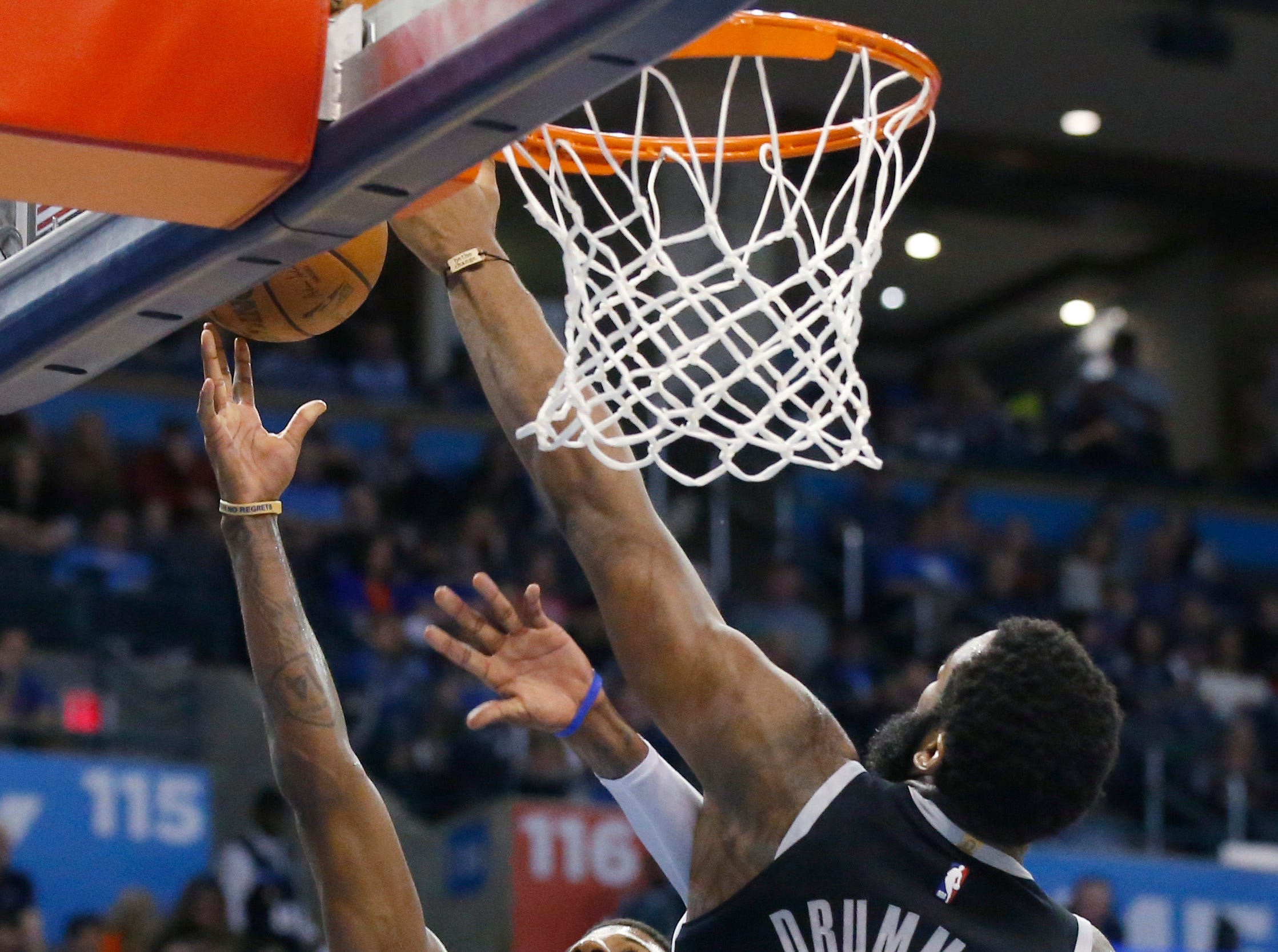 Oklahoma City Thunder forward Paul George (13) shoots as Detroit Pistons center Andre Drummond (0) defends during the second half.