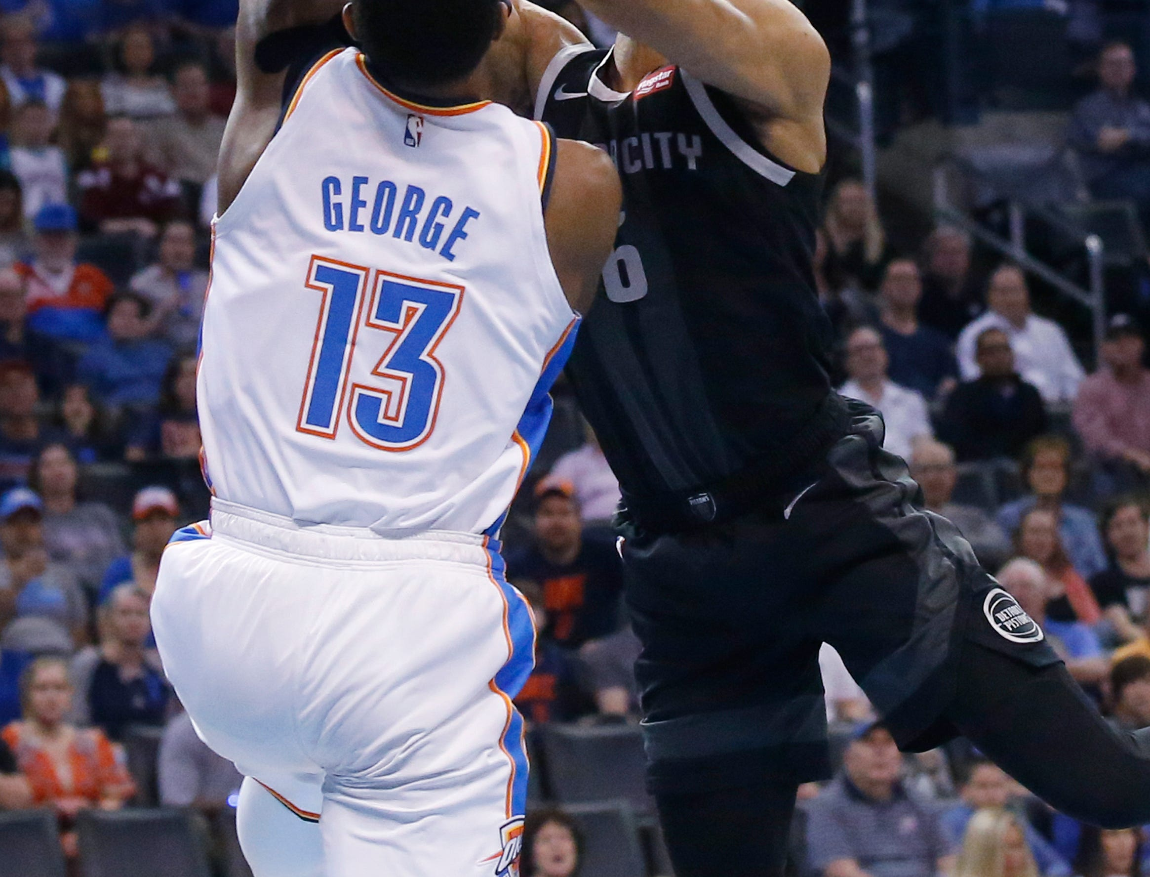 Detroit Pistons guard Bruce Brown (6) is fouled by Oklahoma City Thunder forward Paul George (13) during the first half.