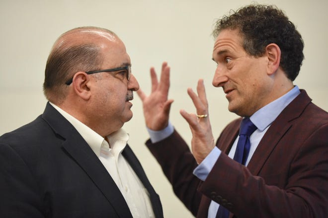 Rep. Andy Levin (right) speaks with Sam Hamana during a meeting concerning the Iraqi deportations at the Chaldean Community Center on Saturday, April 6, 2019.