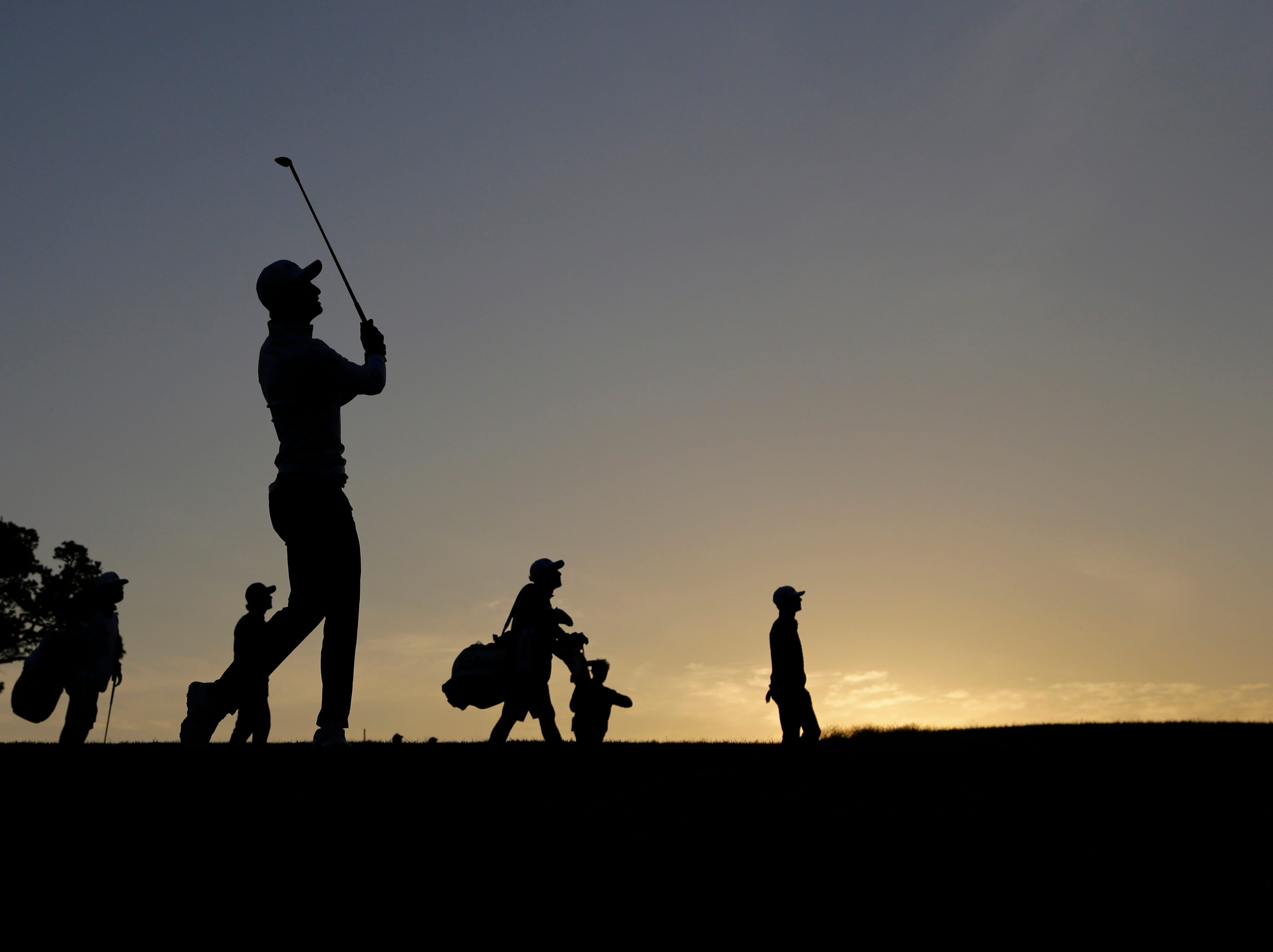 Haotong Li watches his approach shot on the tenth hole during the second round of the Texas Open golf tournament, Friday, April 5, 2019, in San Antonio.