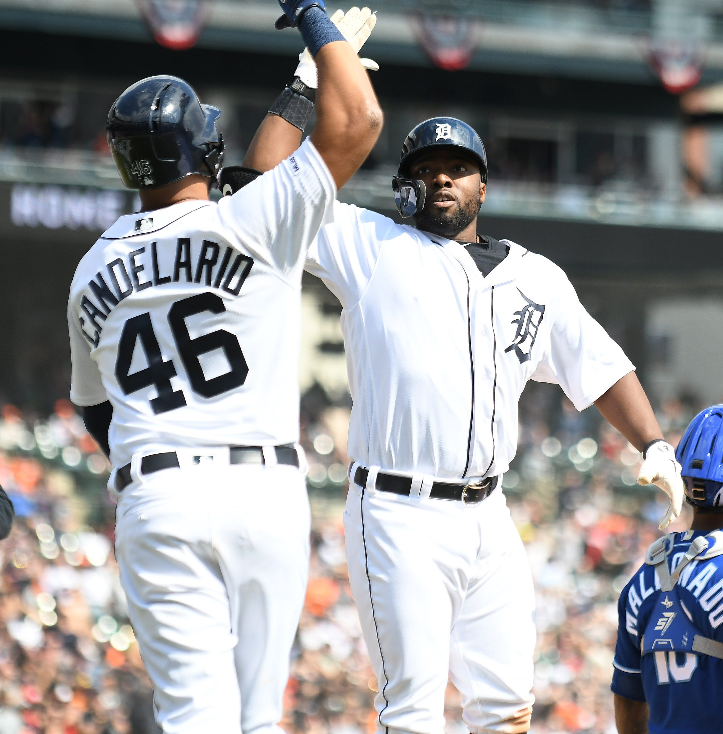 Stewart slam powers Tigers to fourth straight win; Moore injured