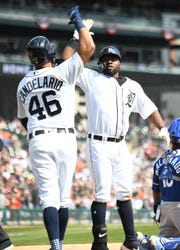Tigers' Jeimer Candelario, left, and Christin Stewart celebrate Stewart's grand slam in the seventh inning. The Tigers won 7-4 Saturday, extending their win streak to four games.