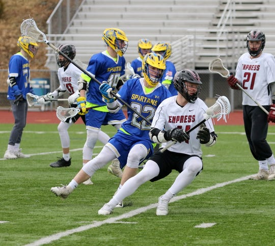 Nate Lashaw of Elmira looks for room as  Kevin Vicari defends for Maine-Endwell during boys lacrosse April 5, 2019 at Ernie Davis Academy.