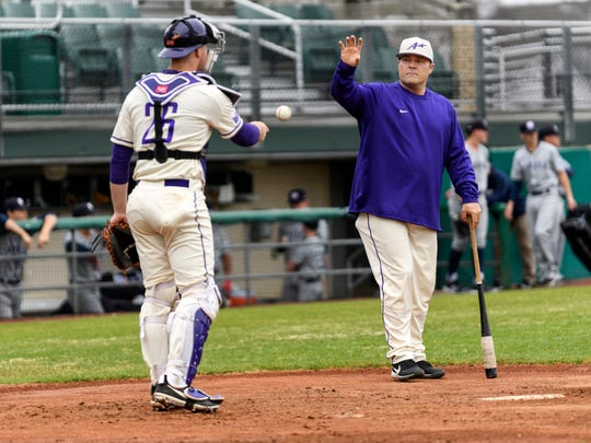 University of Evansville's Jacob Vesecky (26) throws a ball to Head Coach Wes Carroll as they warm up before a game against Dallas Baptist University at Charles H. Braun Stadium in Evansville, Ind., Friday, April 5, 2019. The Purple Aces defeated the Patriots, 8-3, in the first of a three-game home series.