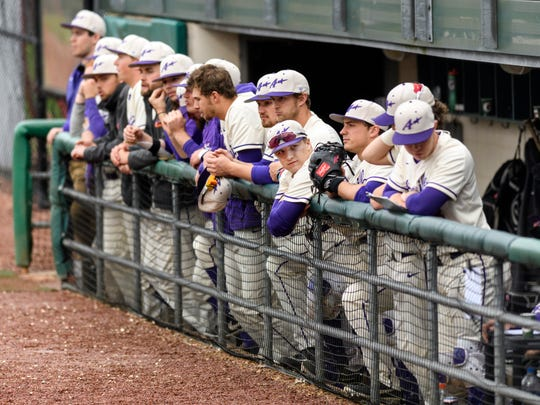 The University of Evansville Purple Aces watch their teammates hit during a game against the Dallas Baptist University Patriots at Charles H. Braun Stadium in Evansville, Ind., Friday, April 5, 2019. The Purple Aces defeated the Patriots, 8-3, in the first of a three-game home series.