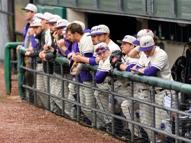 The University of Evansville baseball team watches on during a game against the Dallas Baptist at Braun Stadium in Evansville on April 5. The Aces defeated the Patriots, 8-3.