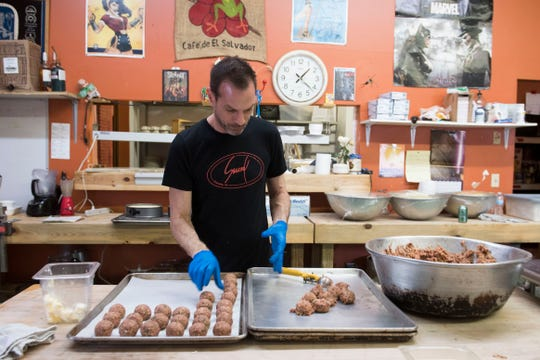 Owner of Sauced, Scott Schymik, rolls meatballs in the kitchen while prepping for dinner Friday, April 5, 2019.