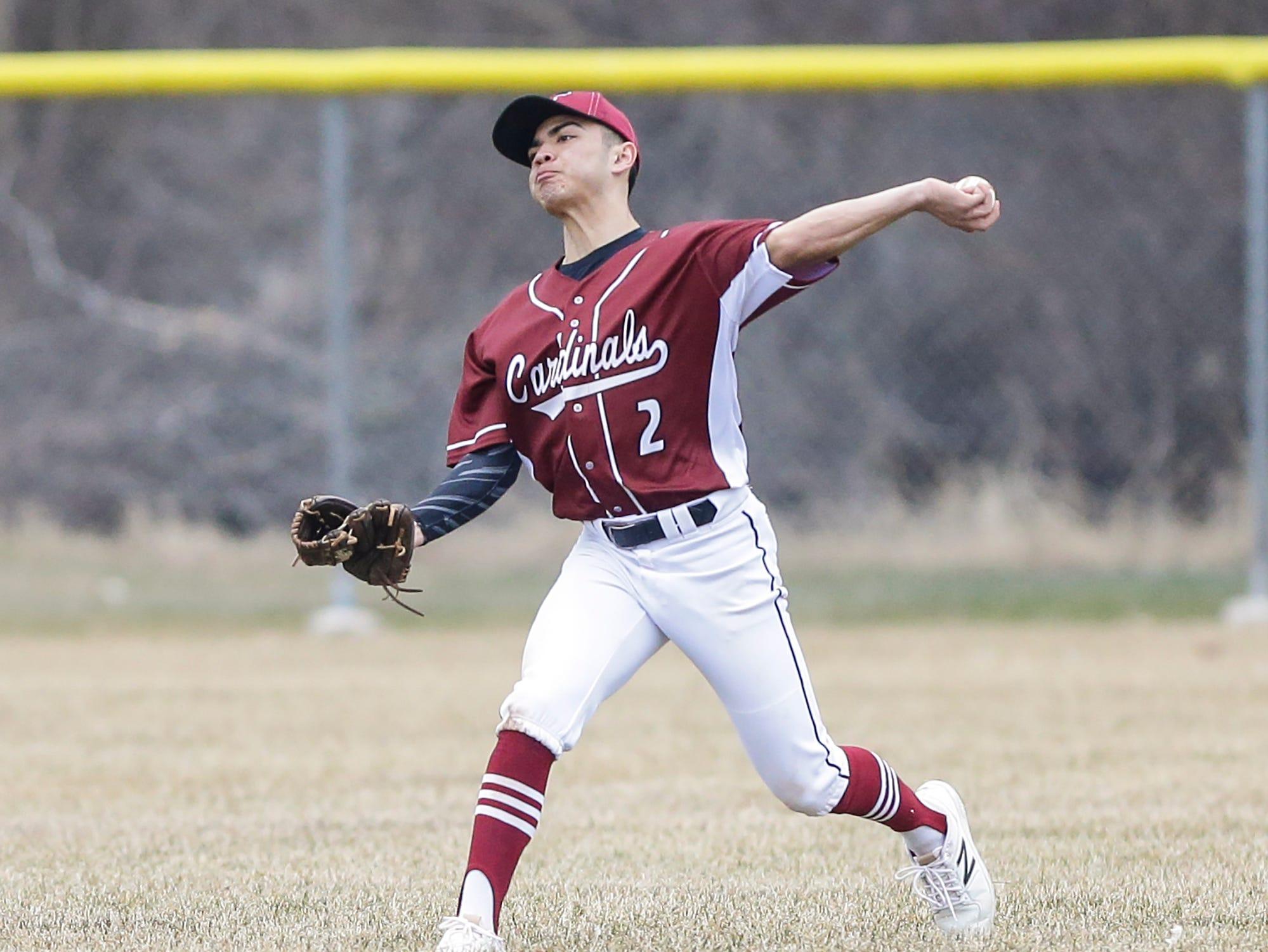 Fond du Lac High School baseball's Julian Murillo fields a ball against Ashwaubenon High School Saturday, April 6, 2019 during their game in Fond du Lac, Wis. Fond du Lac won the game 5-3. Doug Raflik/USA TODAY NETWORK-Wisconsin