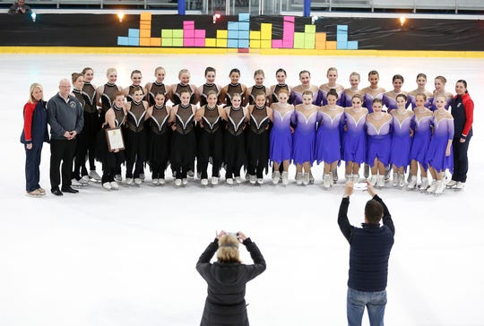 """Wisconsin senator Dan Feyen, second from left, poses with the Fond du Lac Blades Intermediate and Junior Synchronized skating teams Saturday, April 6, 2019 at the Blue Line Family Ice Center in Fond du Lac after presenting them with a """"Citation by the Legislature"""" for """"their outstanding season, commitment to the sport"""" and representation of Fond du Lac and Wisconsin, around the country and abroad."""