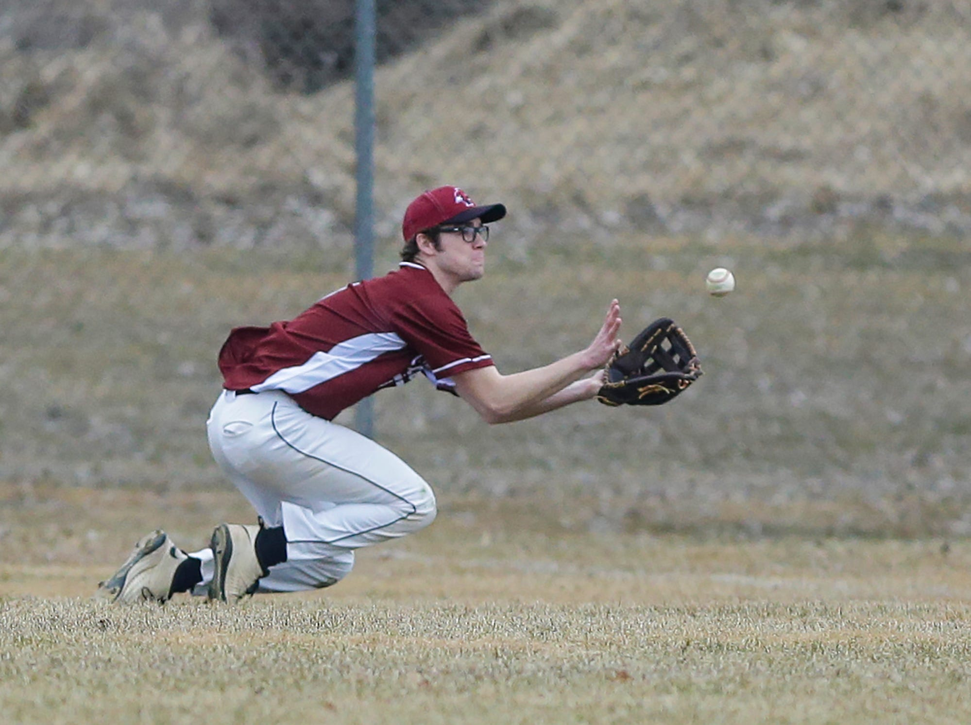 Fond du Lac High School baseball's Drew Bonlander makes a diving catch against Ashwaubenon High School Saturday, April 6, 2019 during their game in Fond du Lac, Wis. Fond du Lac won the game 5-3. Doug Raflik/USA TODAY NETWORK-Wisconsin