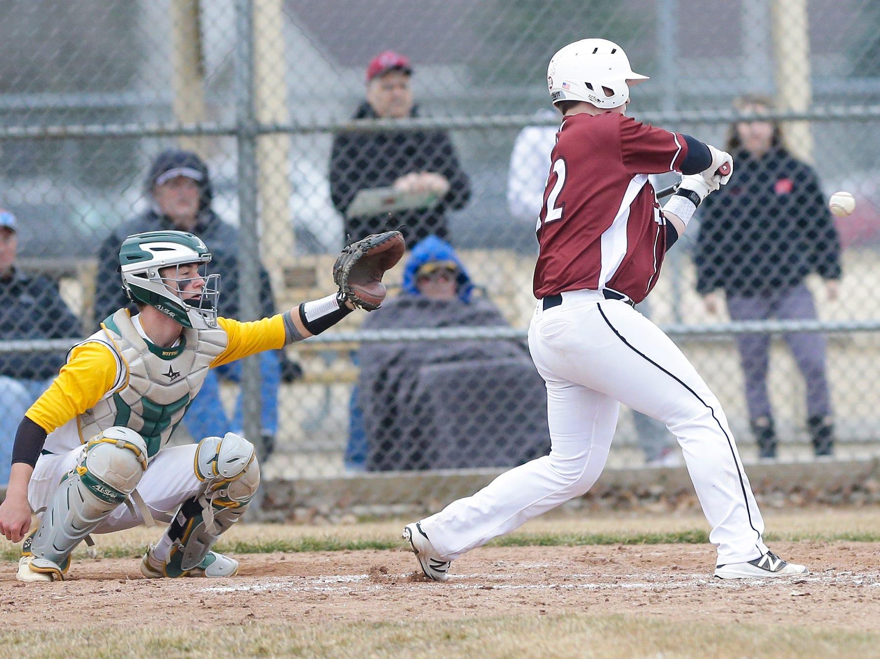 Fond du Lac High School baseball's Dawson Wyrobeck swings at a pitch against Ashwaubenon High School Saturday, April 6, 2019 during their game in Fond du Lac, Wis. Fond du Lac won the game 5-3. Doug Raflik/USA TODAY NETWORK-Wisconsin