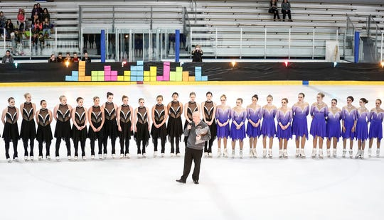"""Wisconsin senator Dan Feyen presents the Fond du Lac Blades Intermediate and Junior Synchronized skating teams with a """"Citation by the Legislature"""" for """"their outstanding season, commitment to the sport"""" and representation of Fond du Lac and Wisconsin, around the country and abroad Saturday, April 6, 2019 at the Blue Line Family Ice Center in Fond du Lac."""