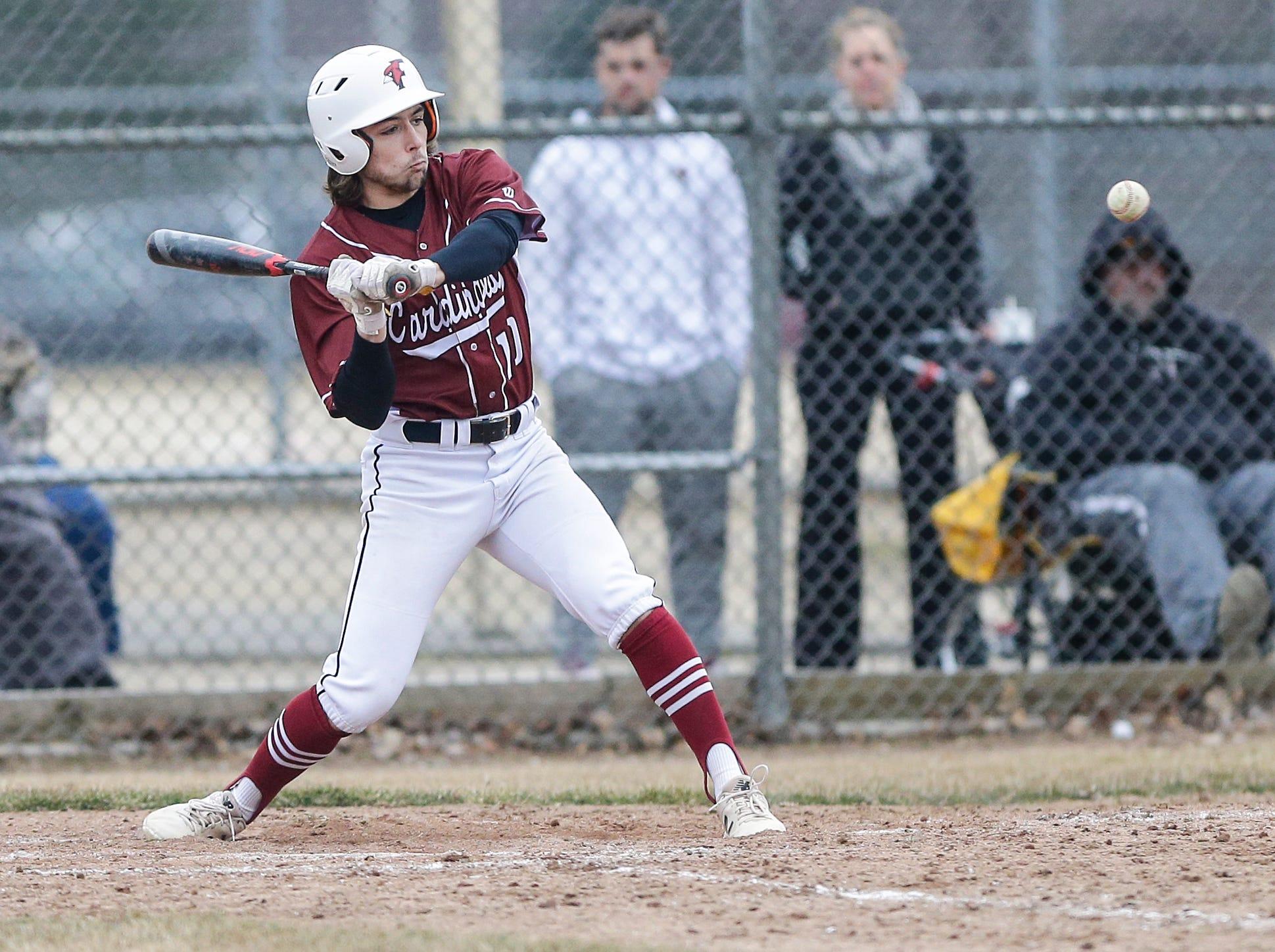 Fond du Lac High School baseball's River Reifsnider hits a single to right field against Ashwaubenon High School Saturday, April 6, 2019 during their game in Fond du Lac, Wis. Fond du Lac won the game 5-3. Doug Raflik/USA TODAY NETWORK-Wisconsin