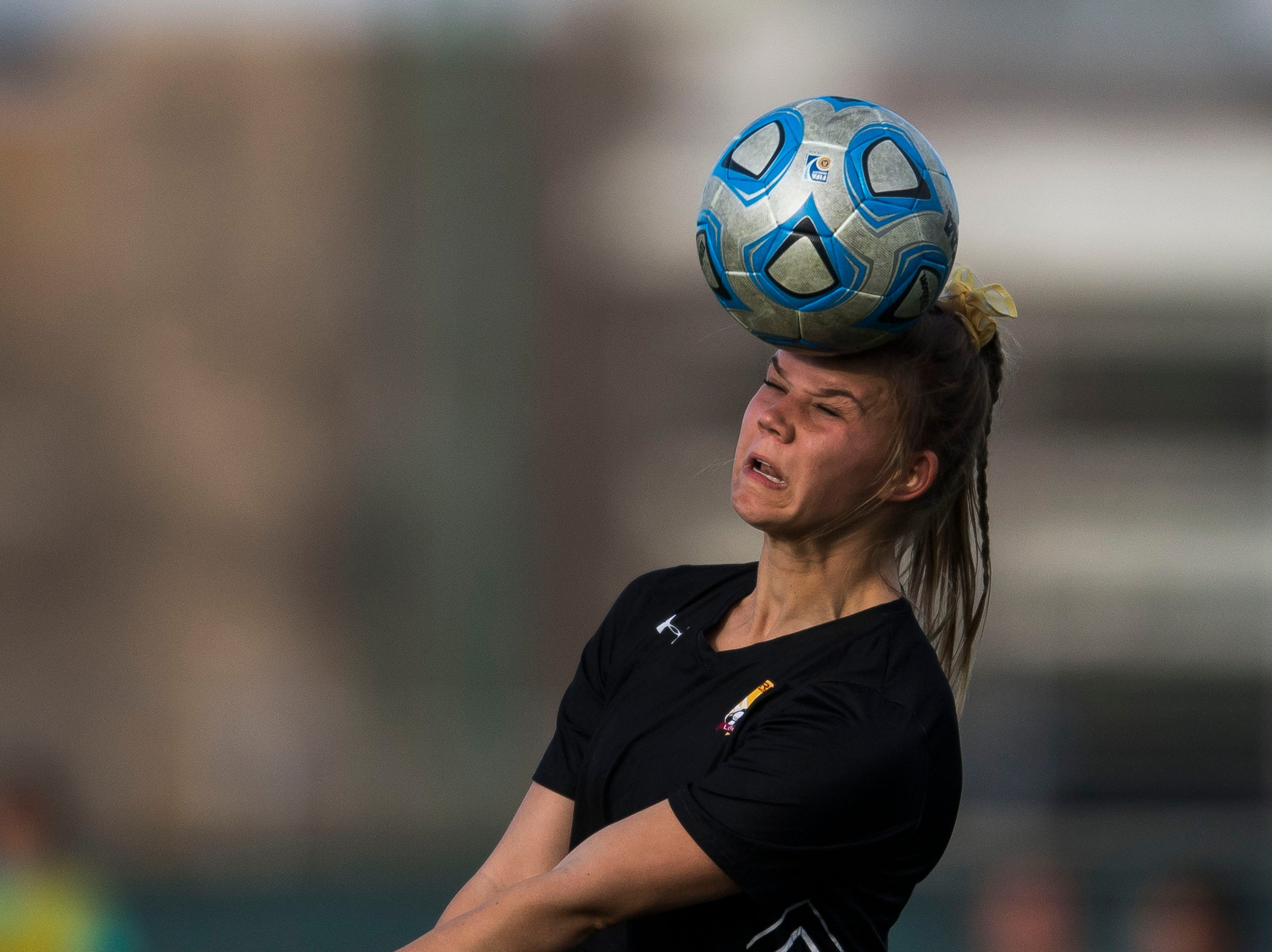 Rocky Mountain High School senior Regan Ostler (2) heads the ball during a game against Fossil Ridge High School on Friday, April 4, 2019, at Colorado State University's soccer field in Fort Collins, Colo.