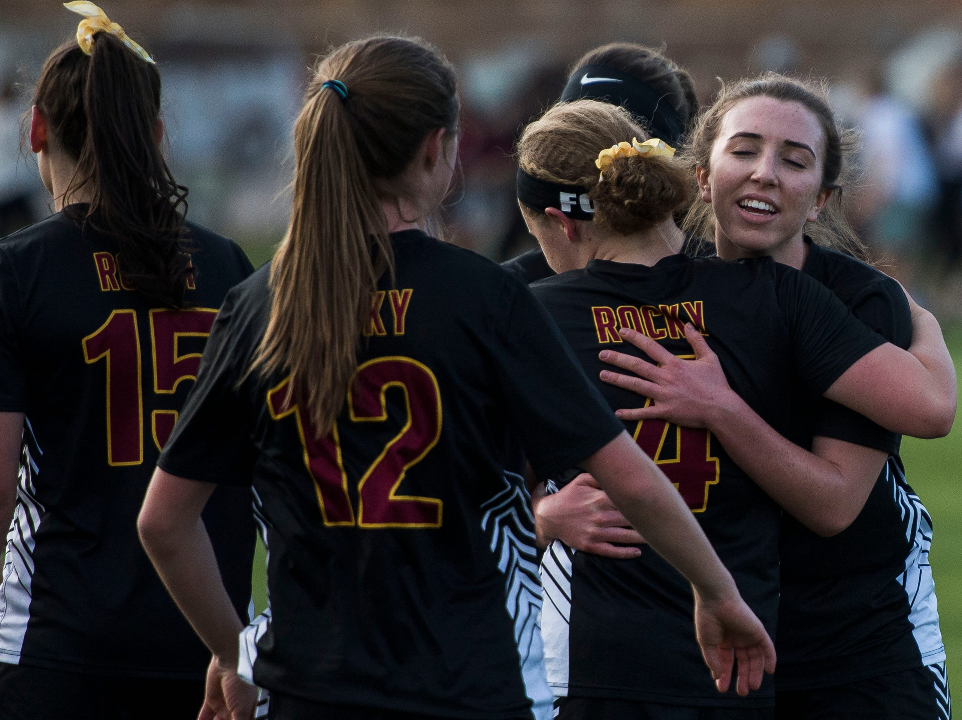 Rocky Mountain High School senior Mikayla Eccher (18) hugs teammate Natalie Ford (4) after a 2-0 win over Fossil Ridge High School on Friday, April 4, 2019, at Colorado State University's soccer field in Fort Collins, Colo.