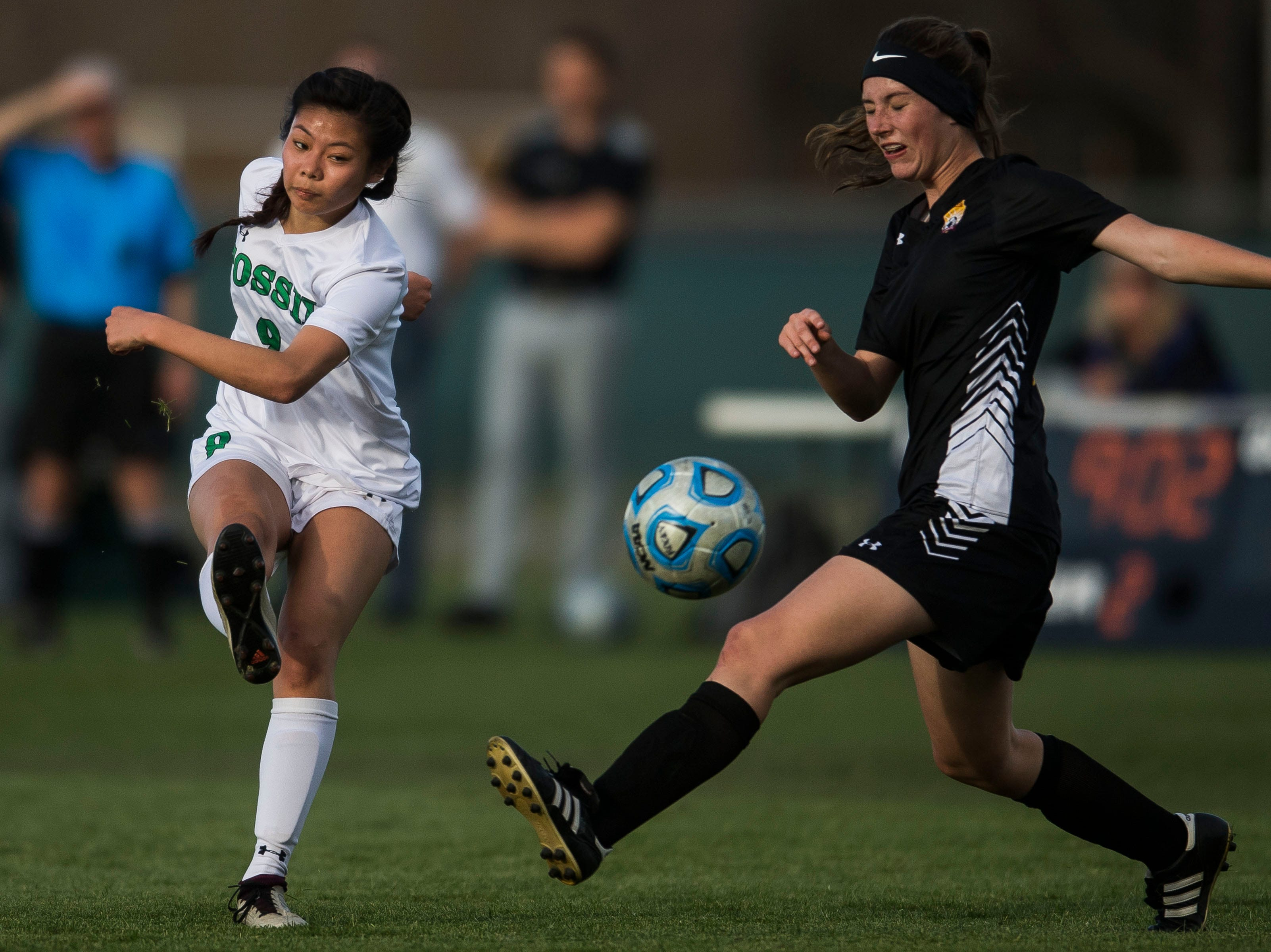 Fossil Ridge High School senior Susan Hsin (9) takes a shot during a game against Rocky Mountain High School on Friday, April 4, 2019, at Colorado State University's soccer field in Fort Collins, Colo.