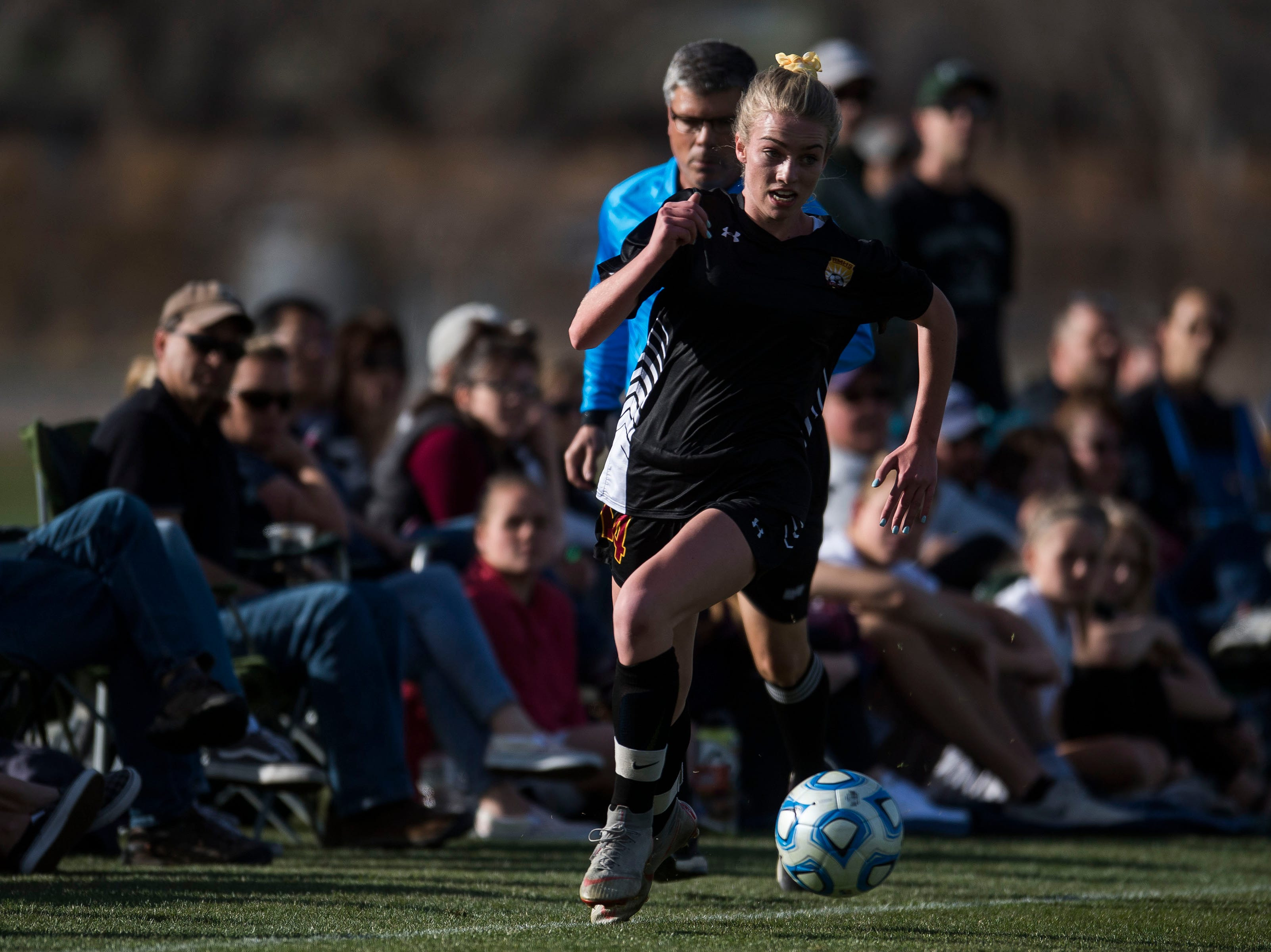 Rocky Mountain High School sophomore Mya Johnson (14) runs down the sideline during a game against Fossil Ridge High School on Friday, April 4, 2019, at Colorado State University's soccer field in Fort Collins, Colo.