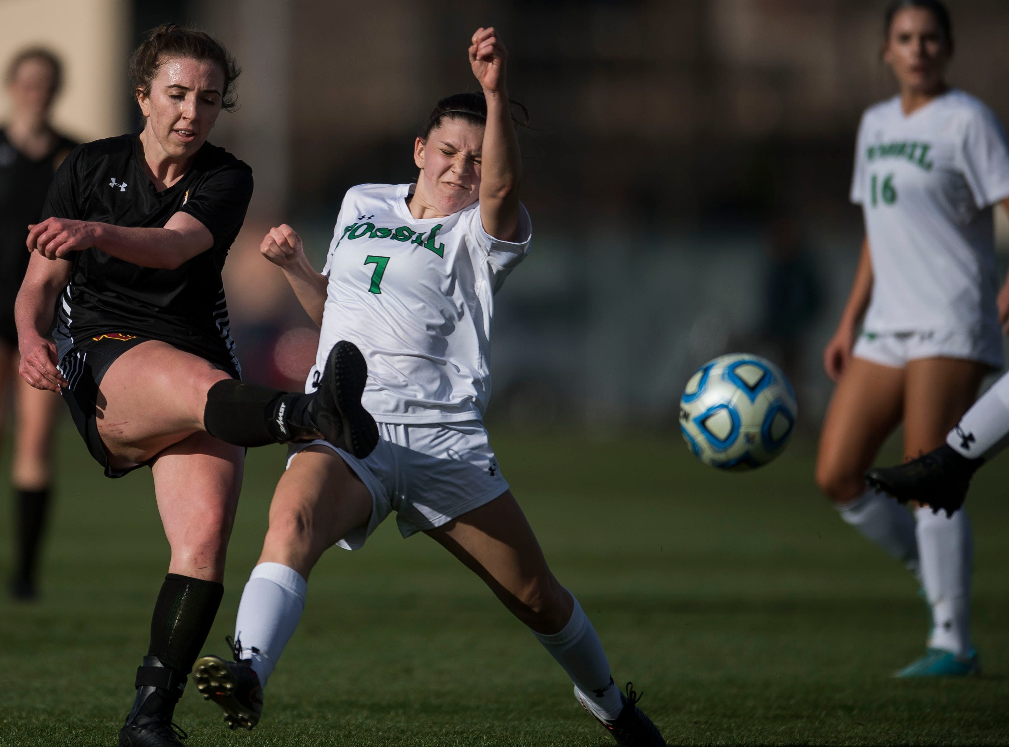 Rocky Mountain High School senior Mikayla Eccher (18) gets a shot past Fossil Ridge High School junior Riley Varoz (7) on Friday, April 4, 2019, at Colorado State University's soccer field in Fort Collins, Colo.