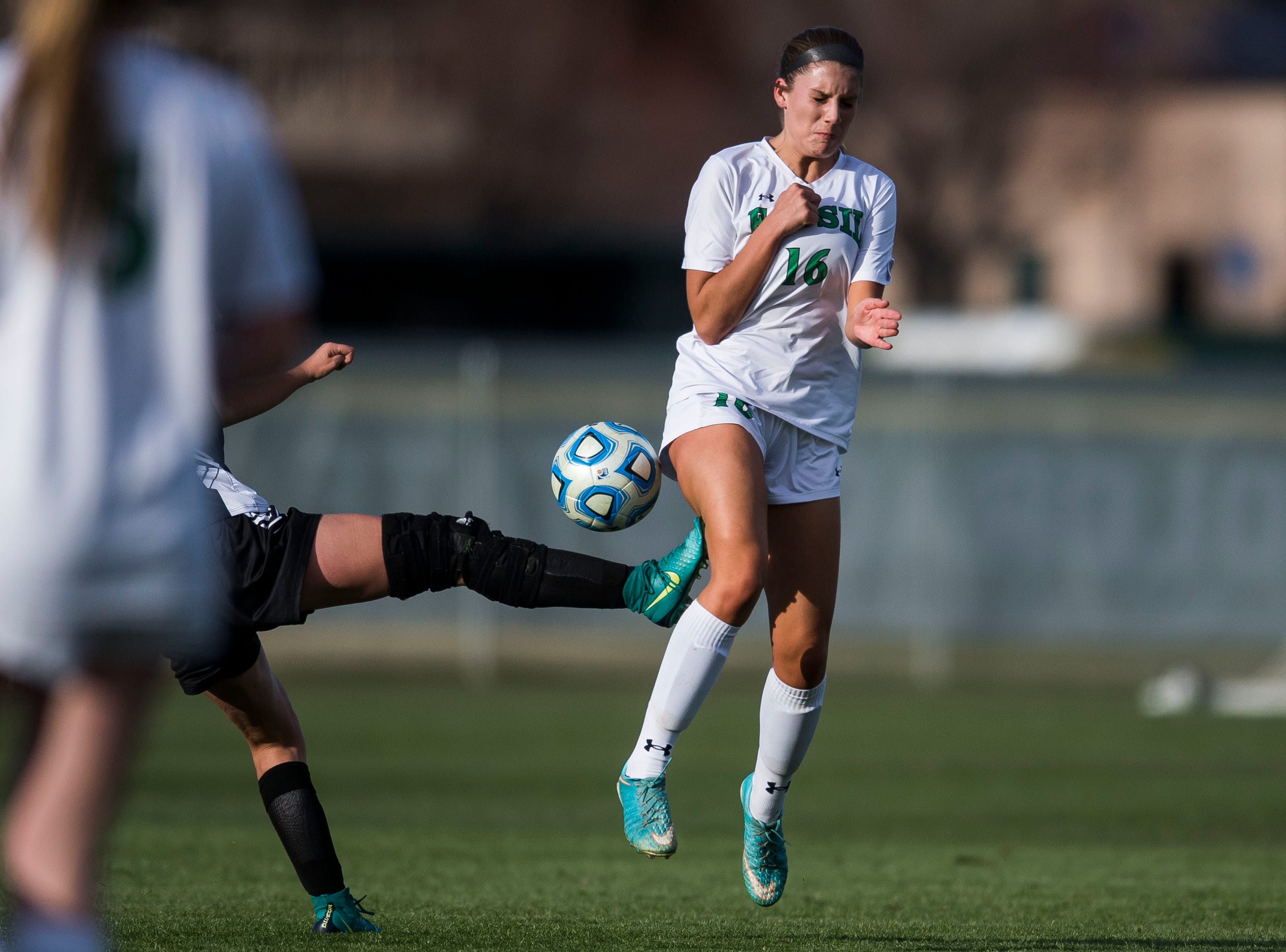 Fossil Ridge High School senior Lauren Martis (16) takes kick while blocking a shot during a game against Rocky Mountain High School on Friday, April 4, 2019, at Colorado State University's soccer field in Fort Collins, Colo.